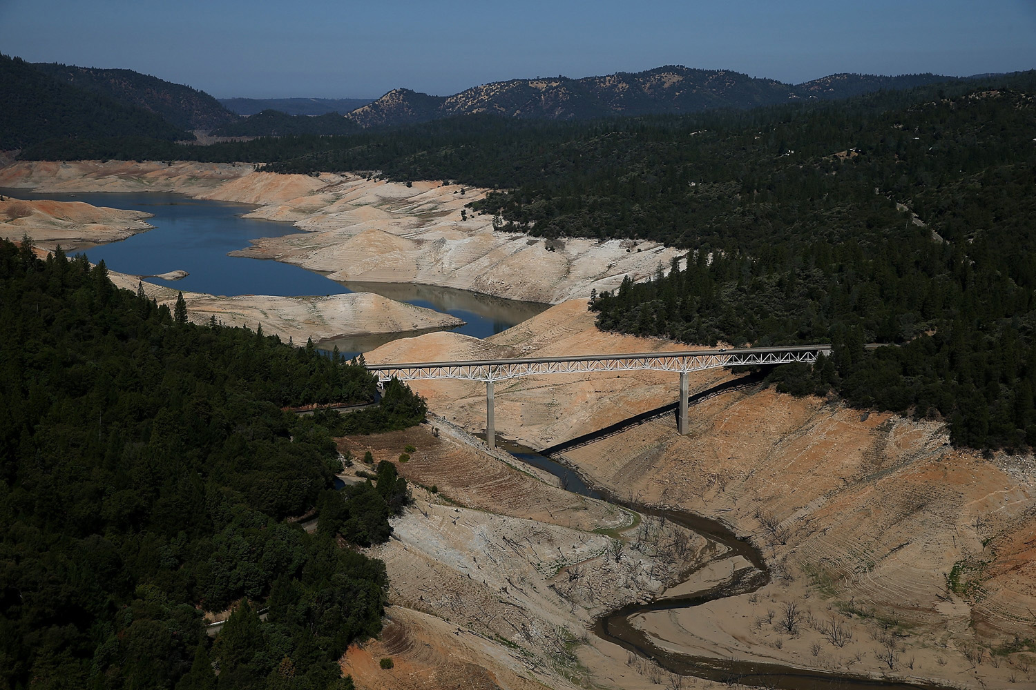 Aug. 19, 2014. The Enterprise Bridge passes over a section of Lake Oroville that is nearly dry in Oroville, California. As the severe drought in California continues for a third straight year, water levels in the State's lakes and reservoirs is reaching historic lows.