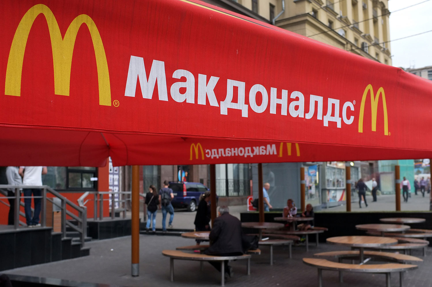 People sit on the terrace of a closed McDonald's restaurant, the first to be opened in the Soviet Union in 1990, in Moscow on Aug. 21, 2014.