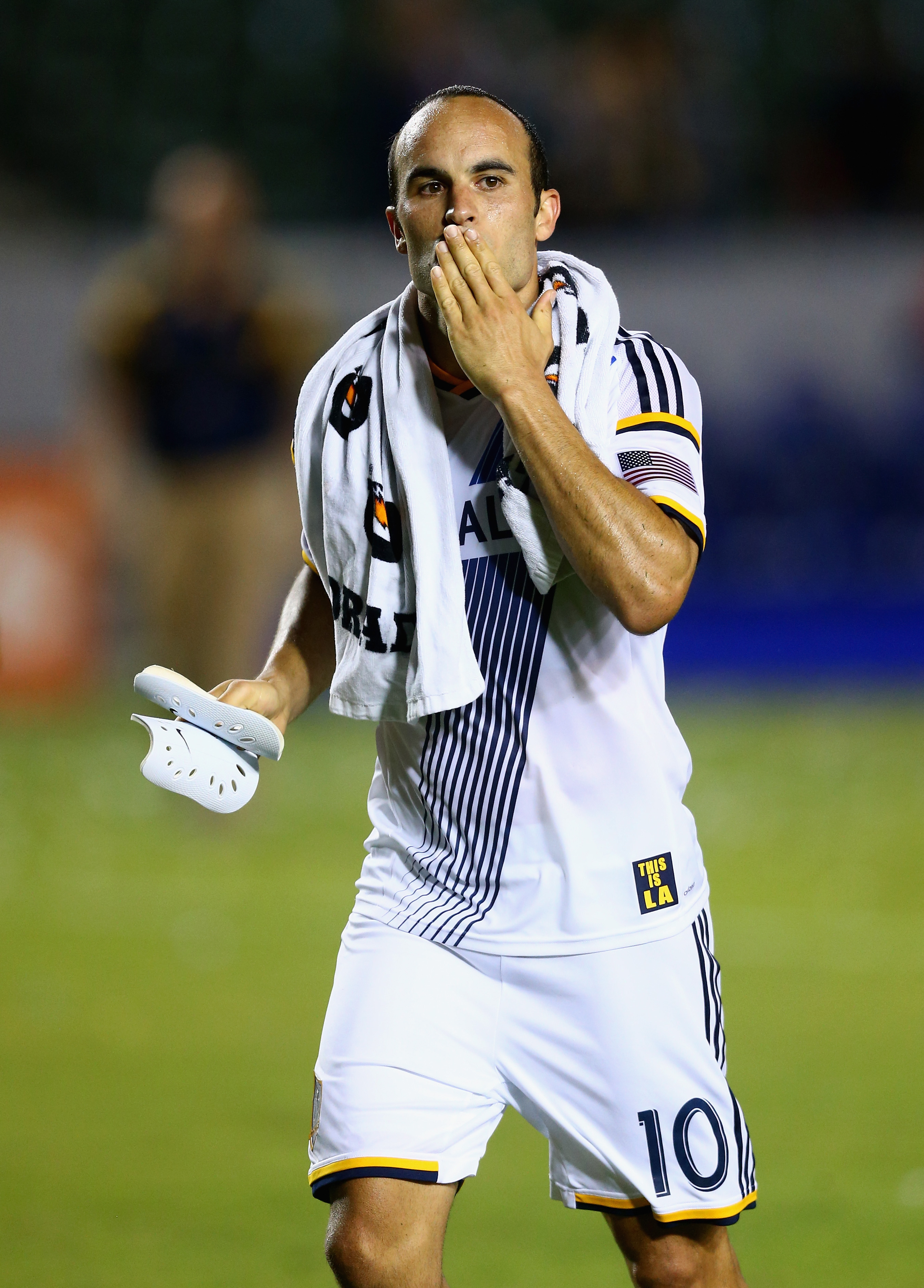 Landon Donovan of Los Angeles Galaxy acknowledges the fans by blowing them a kiss following the game against Vancouver FC at StubHub Center in Los Angeles on Aug. 23, 2014