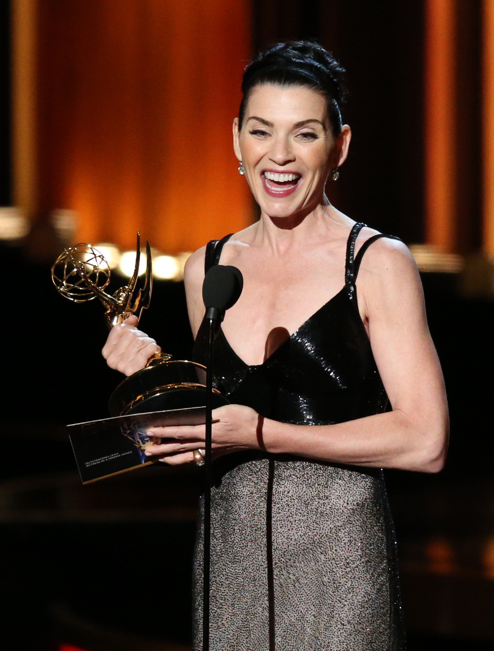Actress Julianna Margulies accepts the Outstanding Lead Actress in a Drama Series award for 'The Good Wife' on stage during the 66th Annual Primetime Emmy Awards held at the Nokia Theater on August 25, 2014.