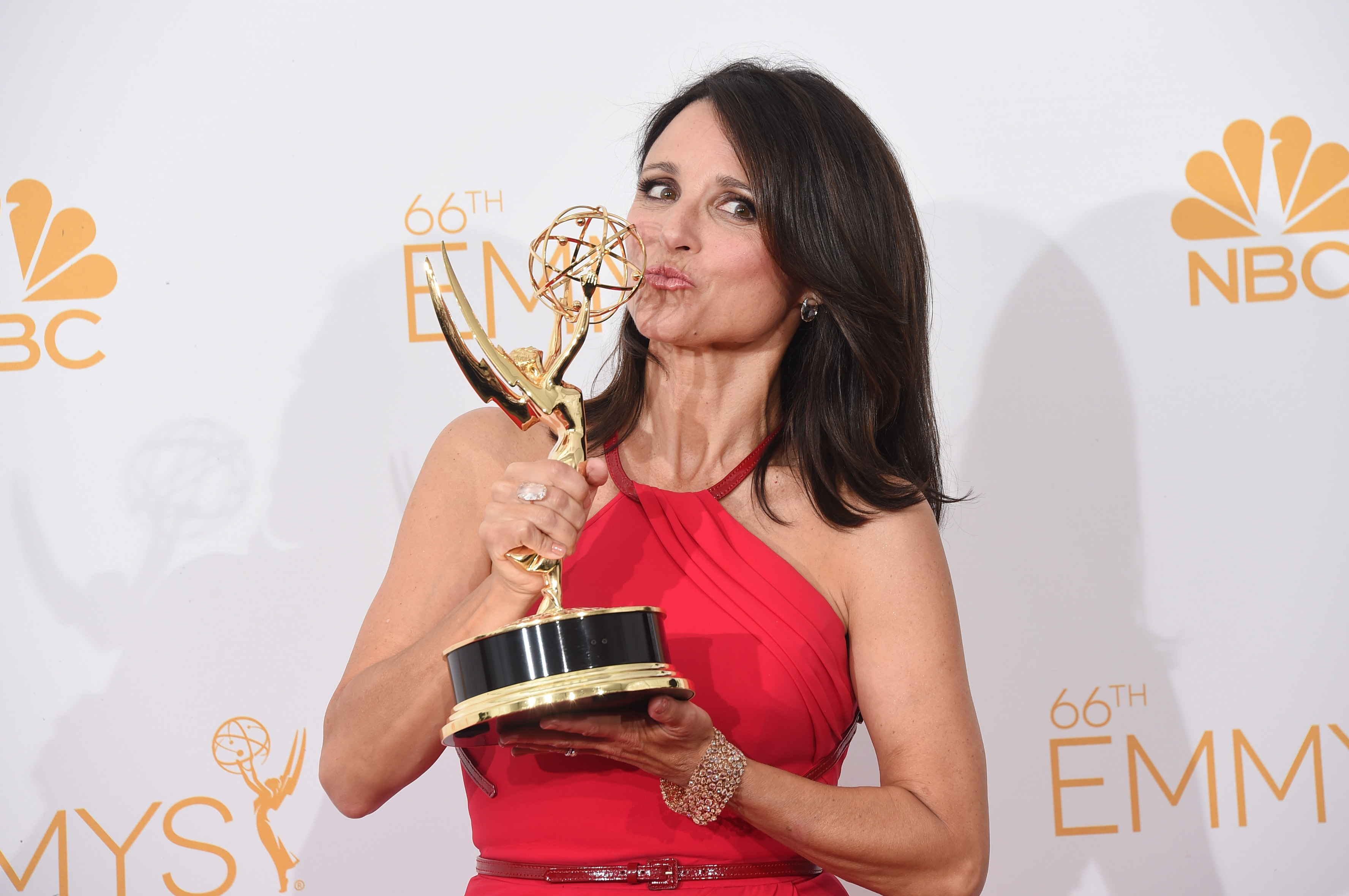 Actress Julia Louis-Dreyfus, winner of the Outstanding Lead Actress in a Comedy Series Award for Veep (Episode:  Crate ), poses in the press room during the 66th Annual Primetime Emmy Awards held at Nokia Theatre L.A. Live on August 25, 2014 in Los Angeles, California.