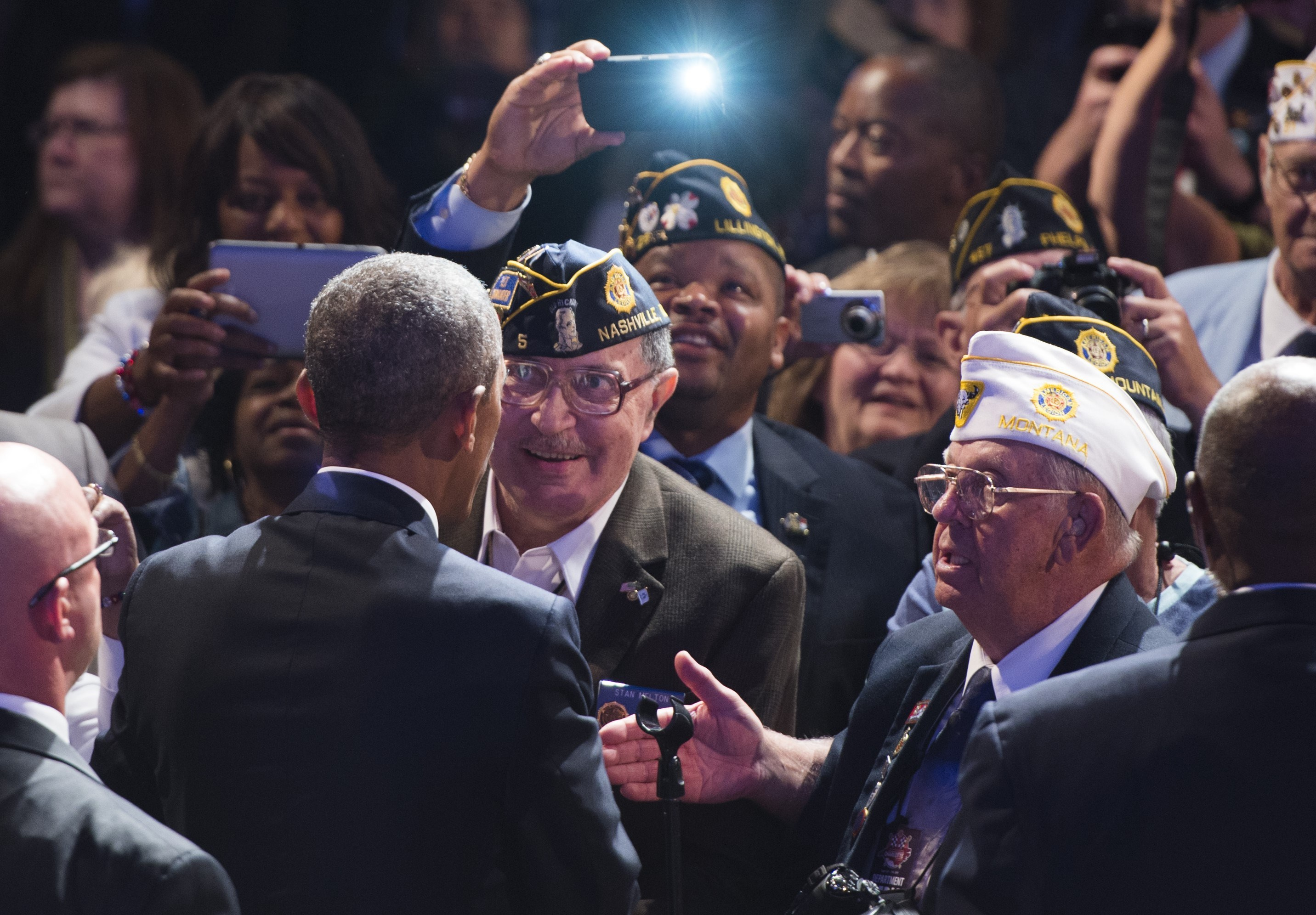 President Barack Obama greets members of the American Legion after speaking at the American Legion's 96th National Convention in Charlotte, North Carolina, August 26, 2014.