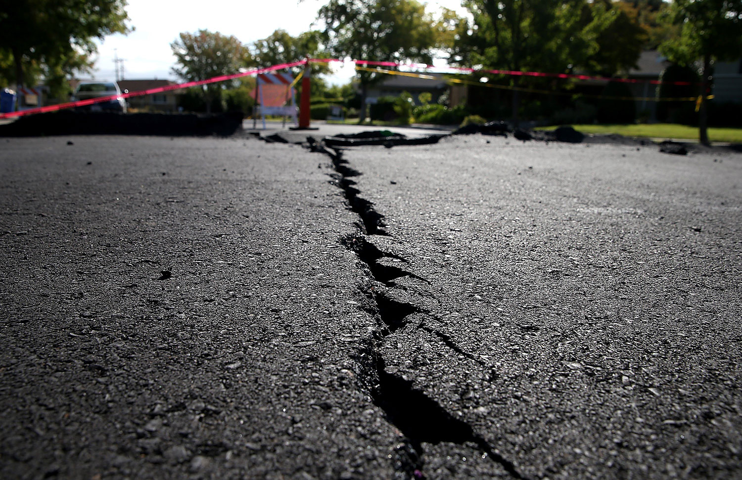 A crack runs down the center of an earthquake-damaged street in Napa, Calif., on Aug. 26, 2014