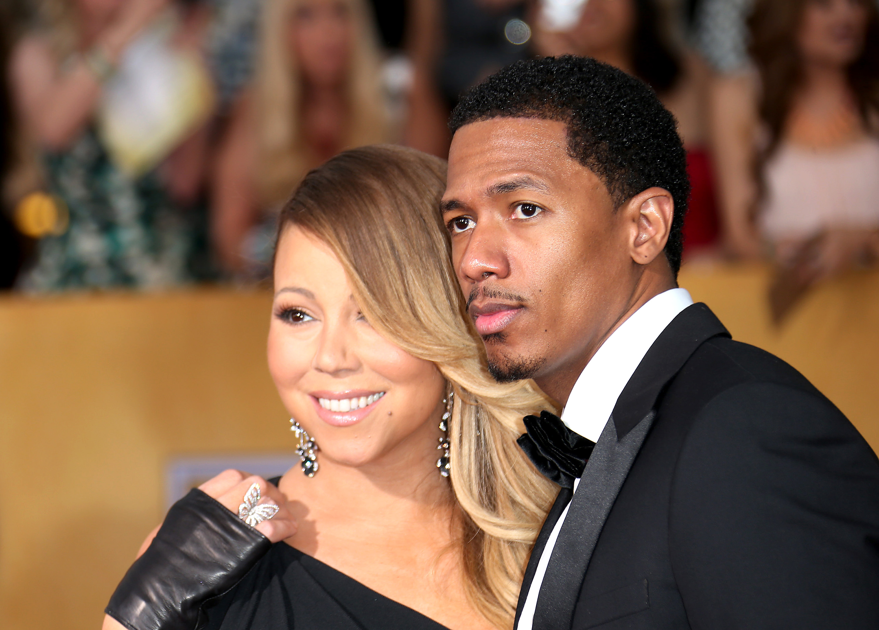 Mariah Carey and Nick Cannon arrive at the 20th Annual Screen Actors Guild Awards at the Shrine Auditorium on January 18, 2014 in Los Angeles, California.