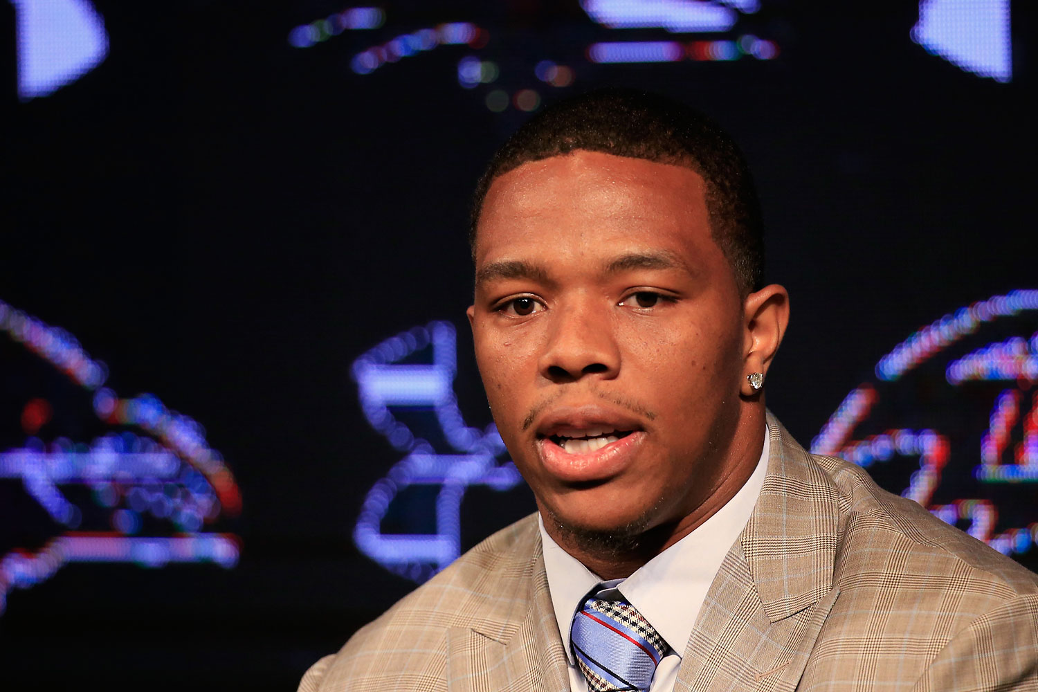 Running back Ray Rice of the Baltimore Ravens addresses a news conference with his wife Janay (not pictured) at the Ravens training center on May 23, 2014 in Owings Mills, Maryland.
