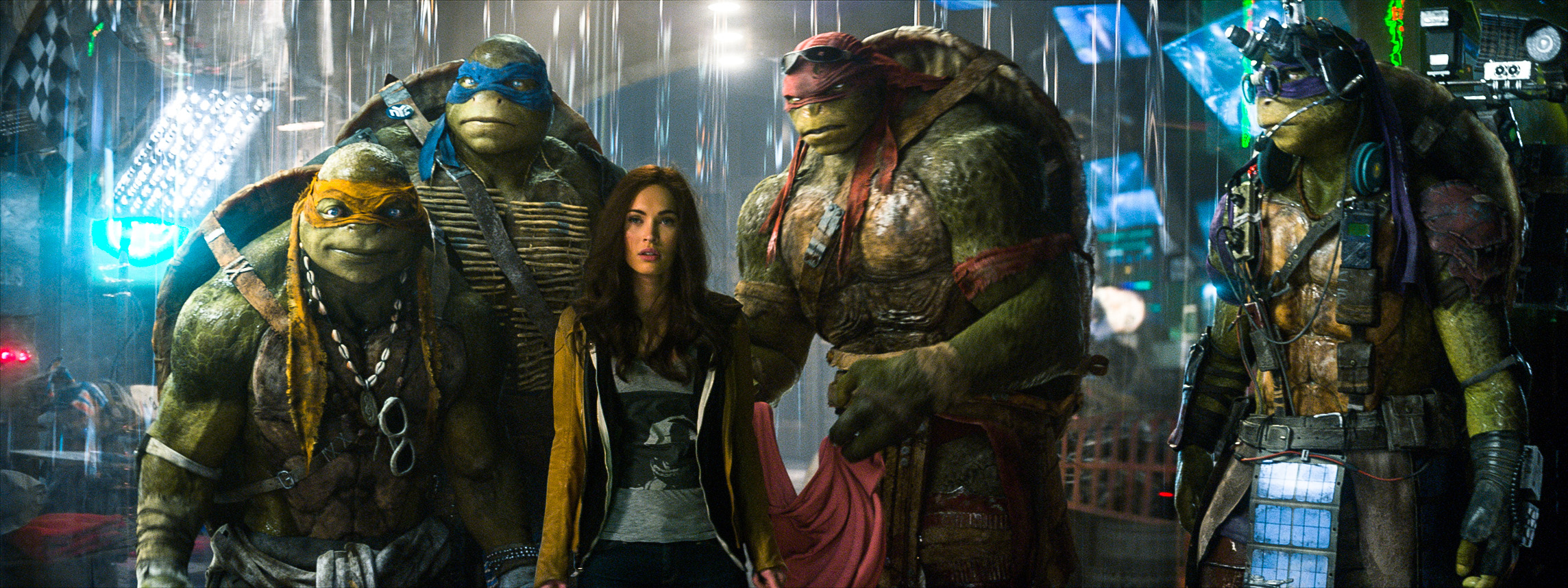 Megan Fox stars as April O'Neil in Teenage Mutant Ninja Turtles alongside (L-R) Michelangelo, Leonardo, Raphael and Donatello.