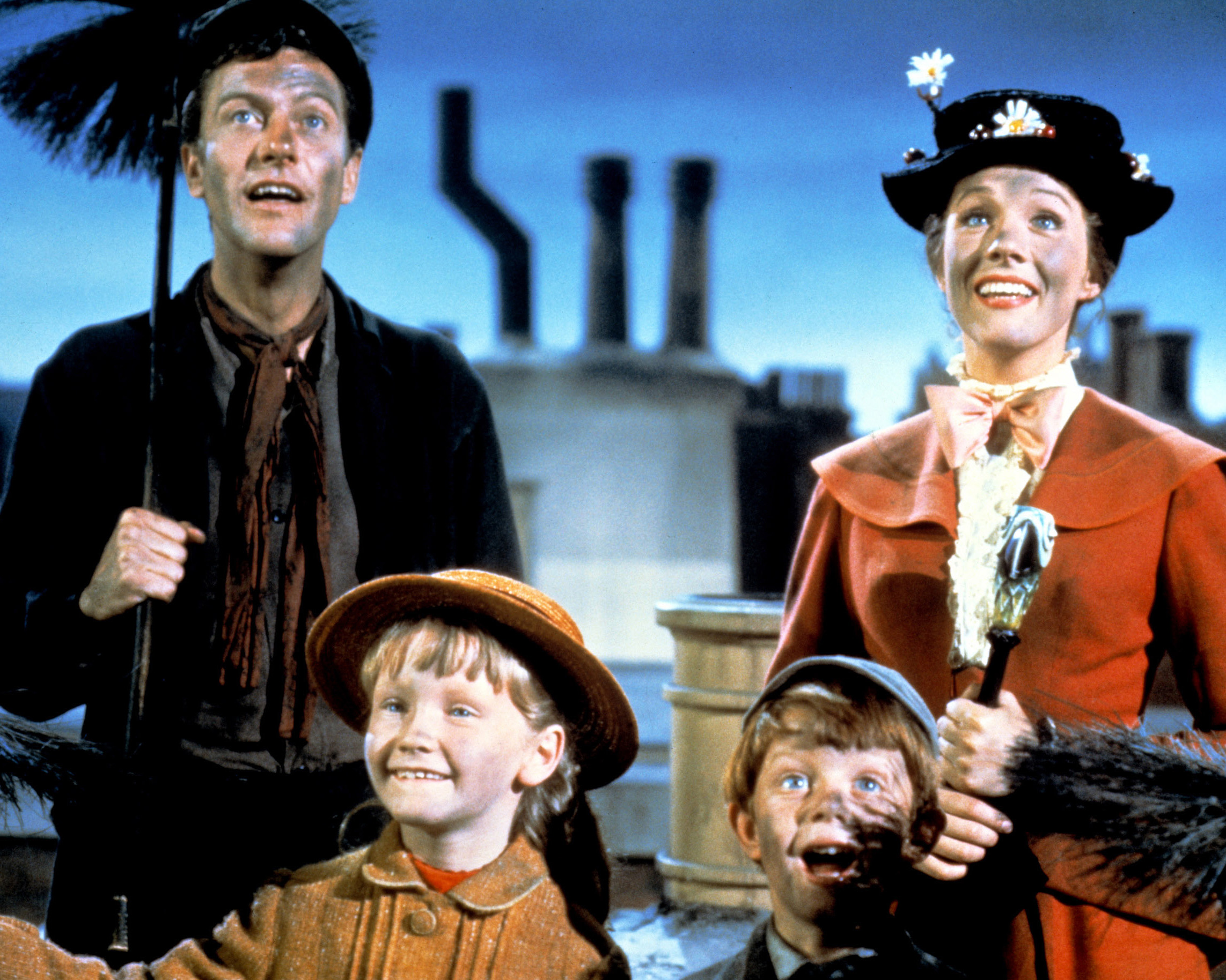 Dick Van Dyke as Bert, Julie Andrews as Mary Poppins, Karen Dotrice as Jane Banks and Matthew Garber as Michael Banks in the Disney musical 'Mary Poppins.'