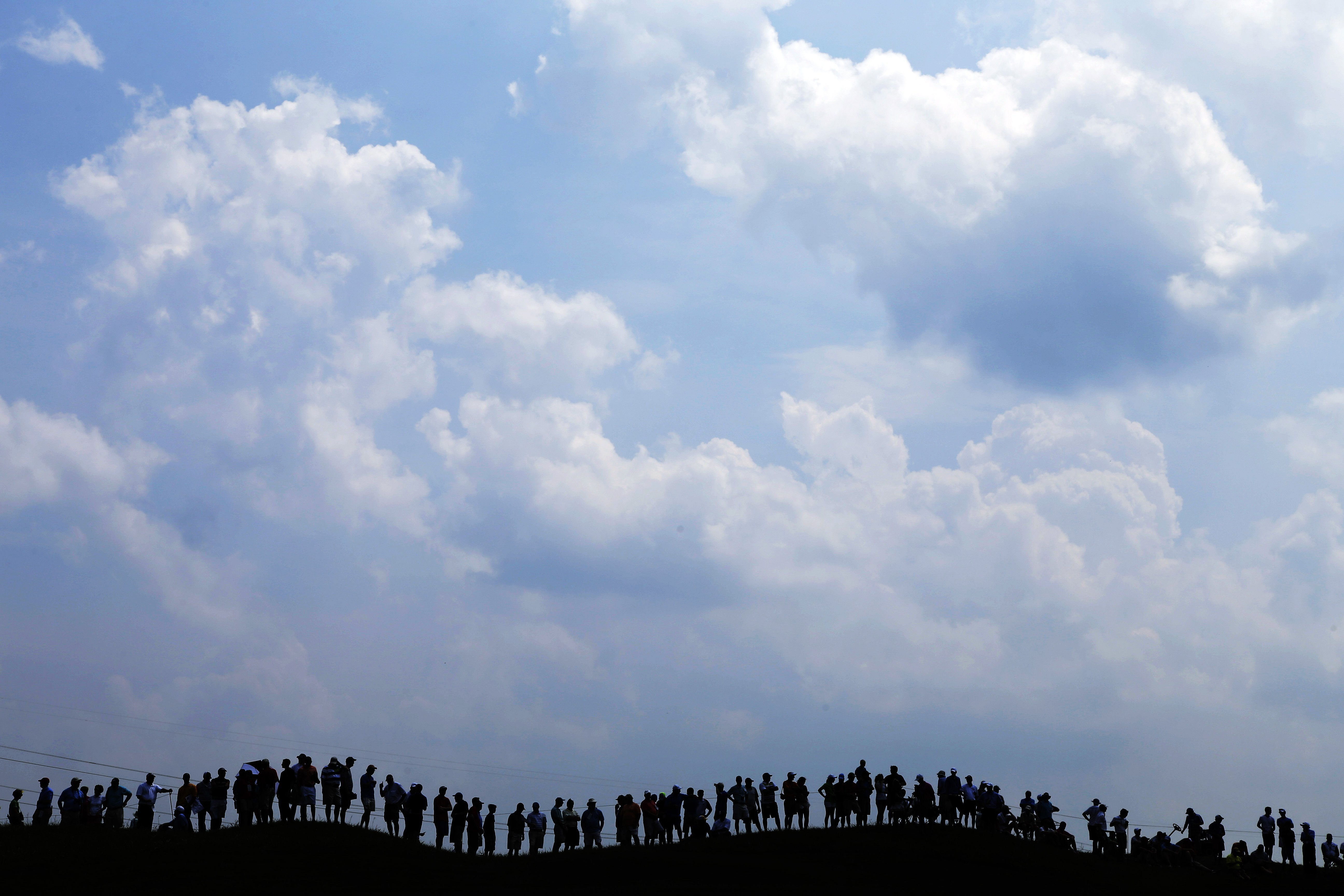 Aug. 6, 2014. Fans line the fourth fairway to watch Tiger Woods during a practice round for the PGA Championship golf tournament at Valhalla Golf Club in Louisville, Ky.
