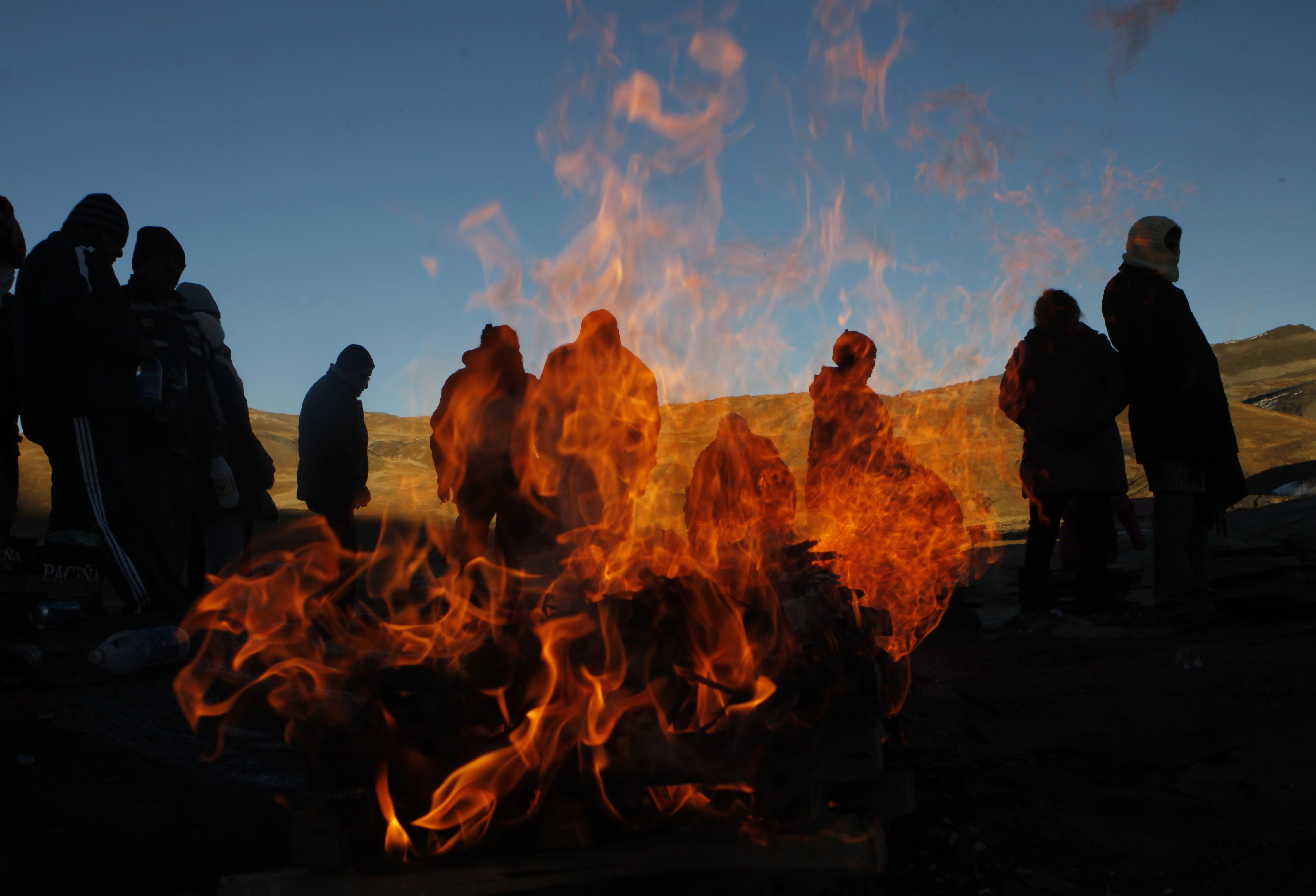 Aug. 1, 2014. People burn offerings to  Pachamama,  or  Mother Earth,  on La Cumbre, a mountain that is considered scared ground, on the outskirts of La Paz, Bolivia.