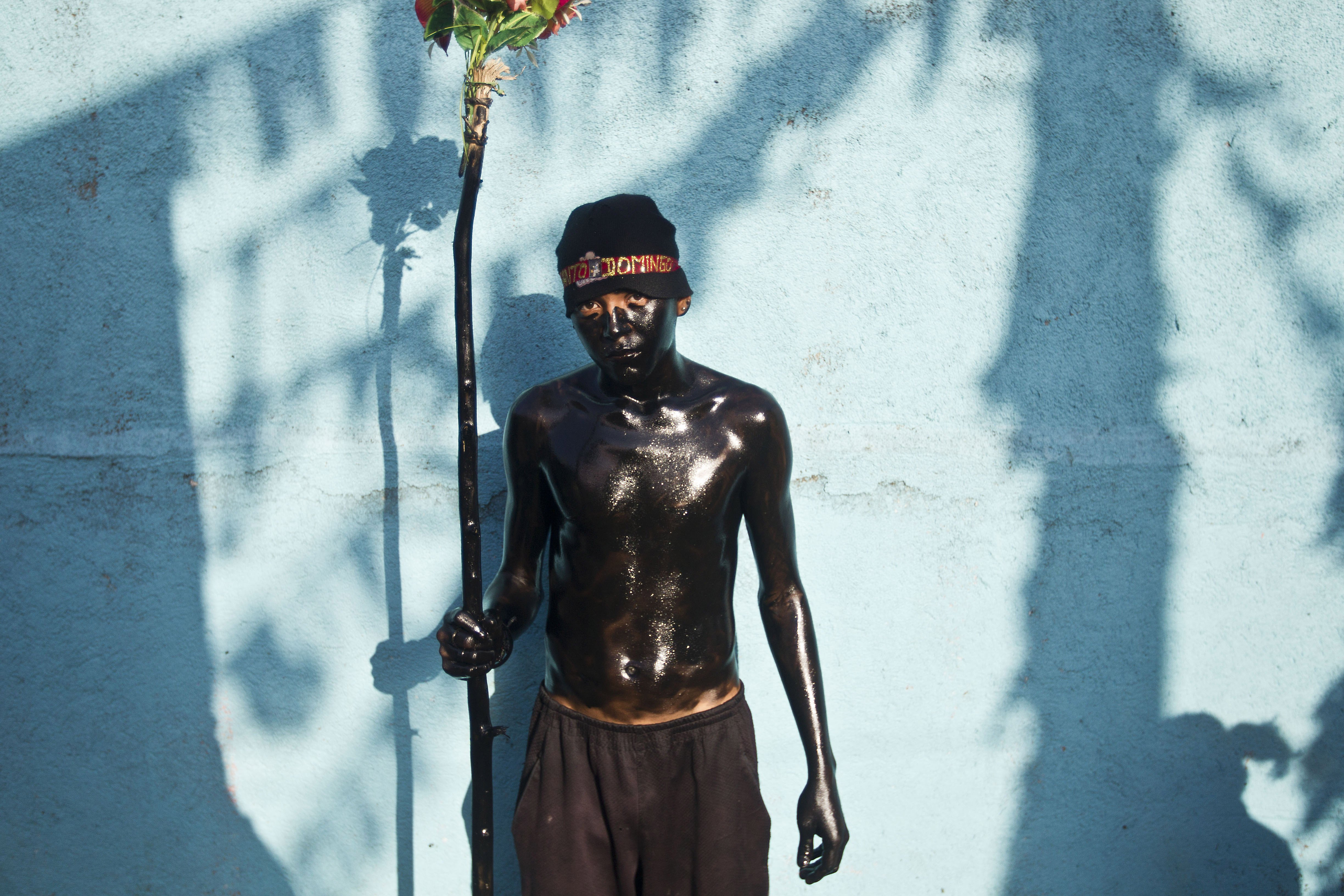 Aug. 1, 2014. A young man, his body drenched with used motor oil, poses for a photo during festivities honoring patron saint Santo Domingo de Guzman, in Managua, Nicaragua.