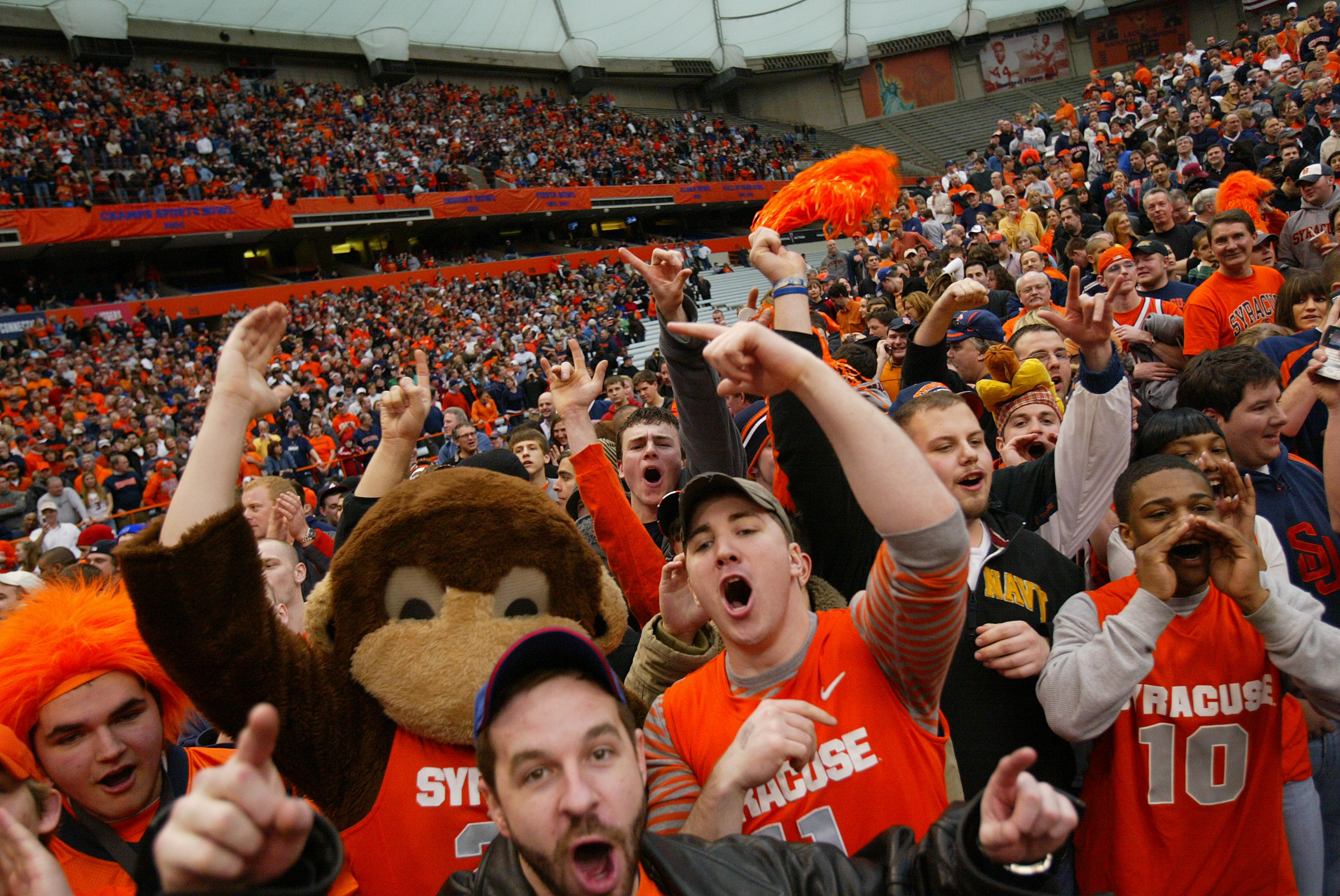 People cheer during the game between the Georgetown University Hoyas and the Syracuse Orange at the Carrier Dome February 16, 2008 in Syracuse, New York.