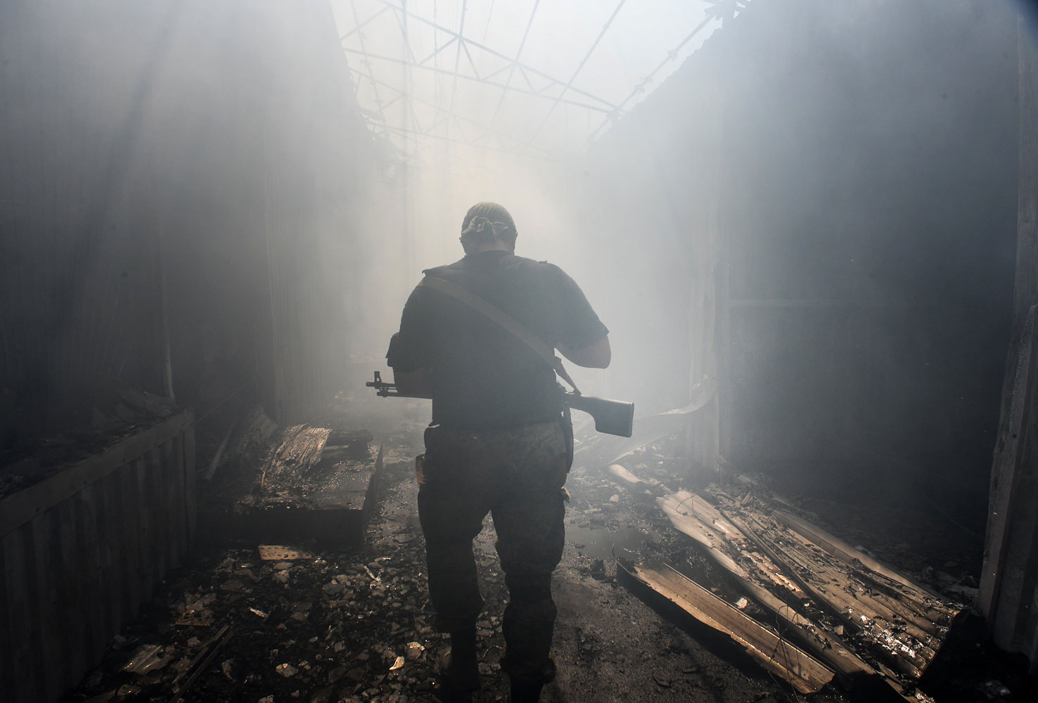 A pro-Russian rebel walks in a passage at a local market damaged by shelling in the town of Donetsk, eastern Ukraine, on Aug. 26, 2014