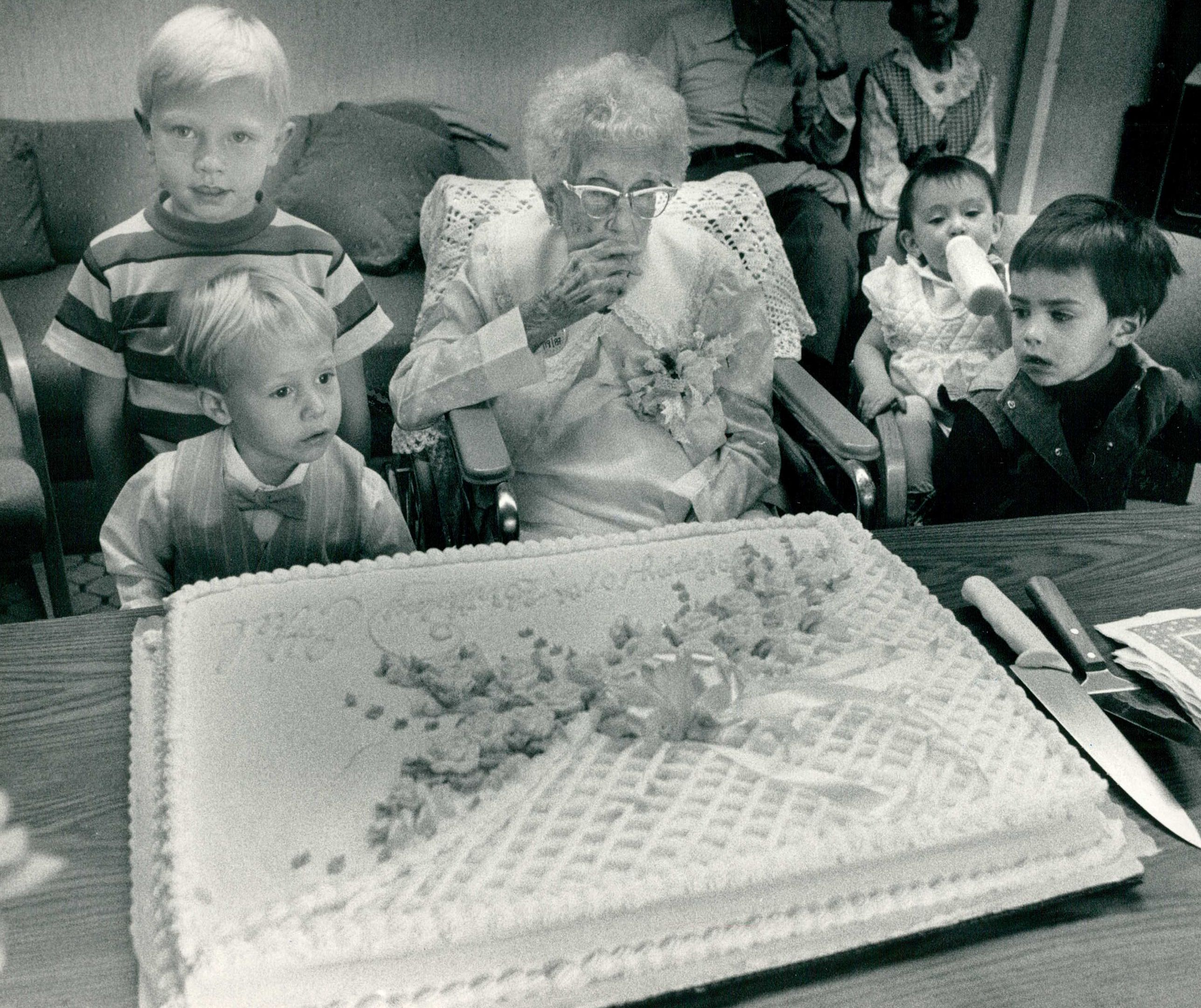 Ethel Lang celebrates her  birthday with her great great grandchildren on Sept. 21, 1987 in the Bear Creek Nursing Home. Lang was born on May 27, 1900, and is now 114.
