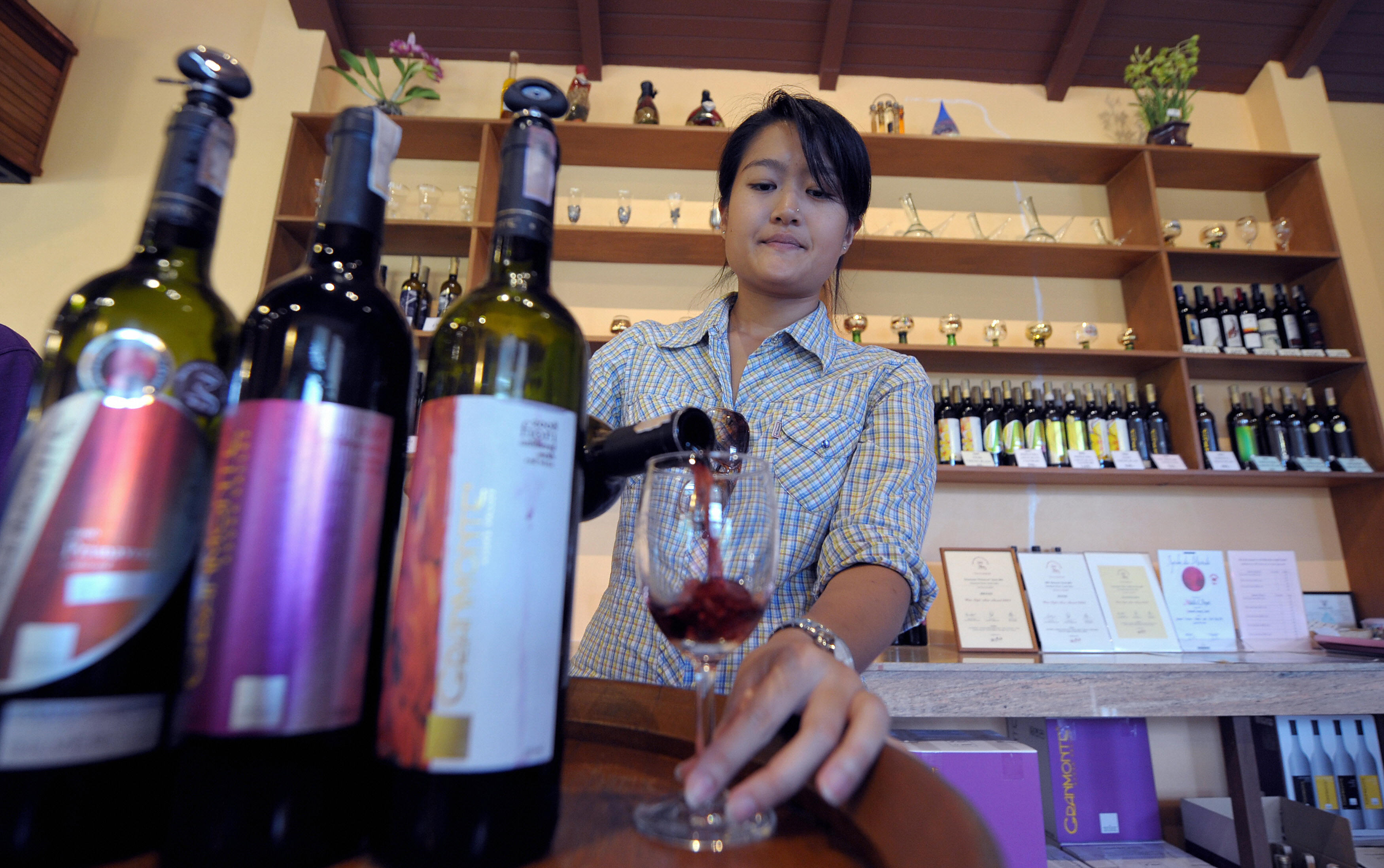 In a picture taken on July 6, 2009, Nikki Lohitnavy, Thailand's first female winemaker tests her wine at a wineshop in Khao Yai National Park 155km (96 miles) north of Bangkok.