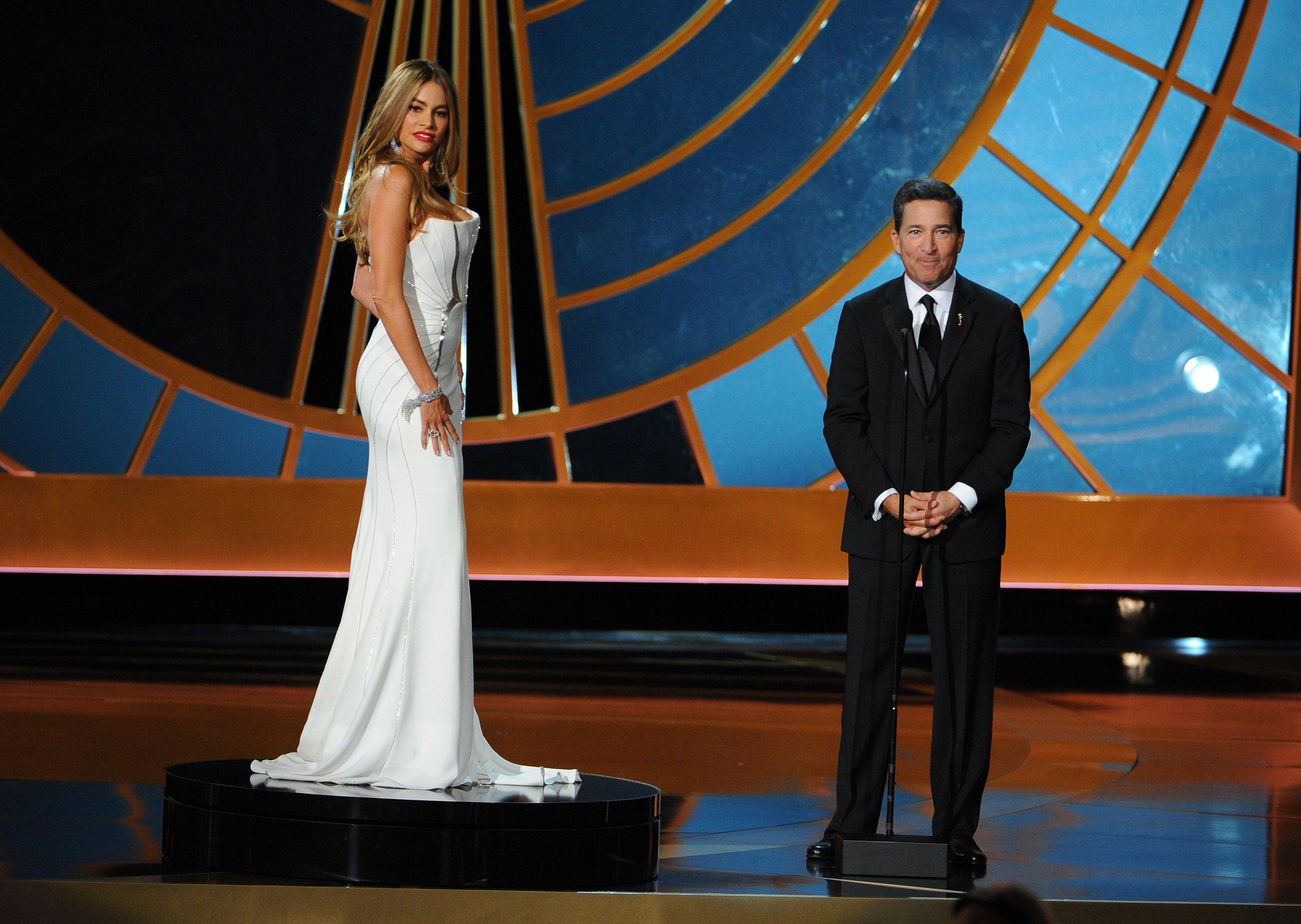 Sofia Vergara, left, and Television Academy CEO Bruce Rosenblum speak on stage at the 66th Primetime Emmy Awards at the Nokia Theatre L.A. Live on Monday, Aug. 25, 2014, in Los Angeles.
