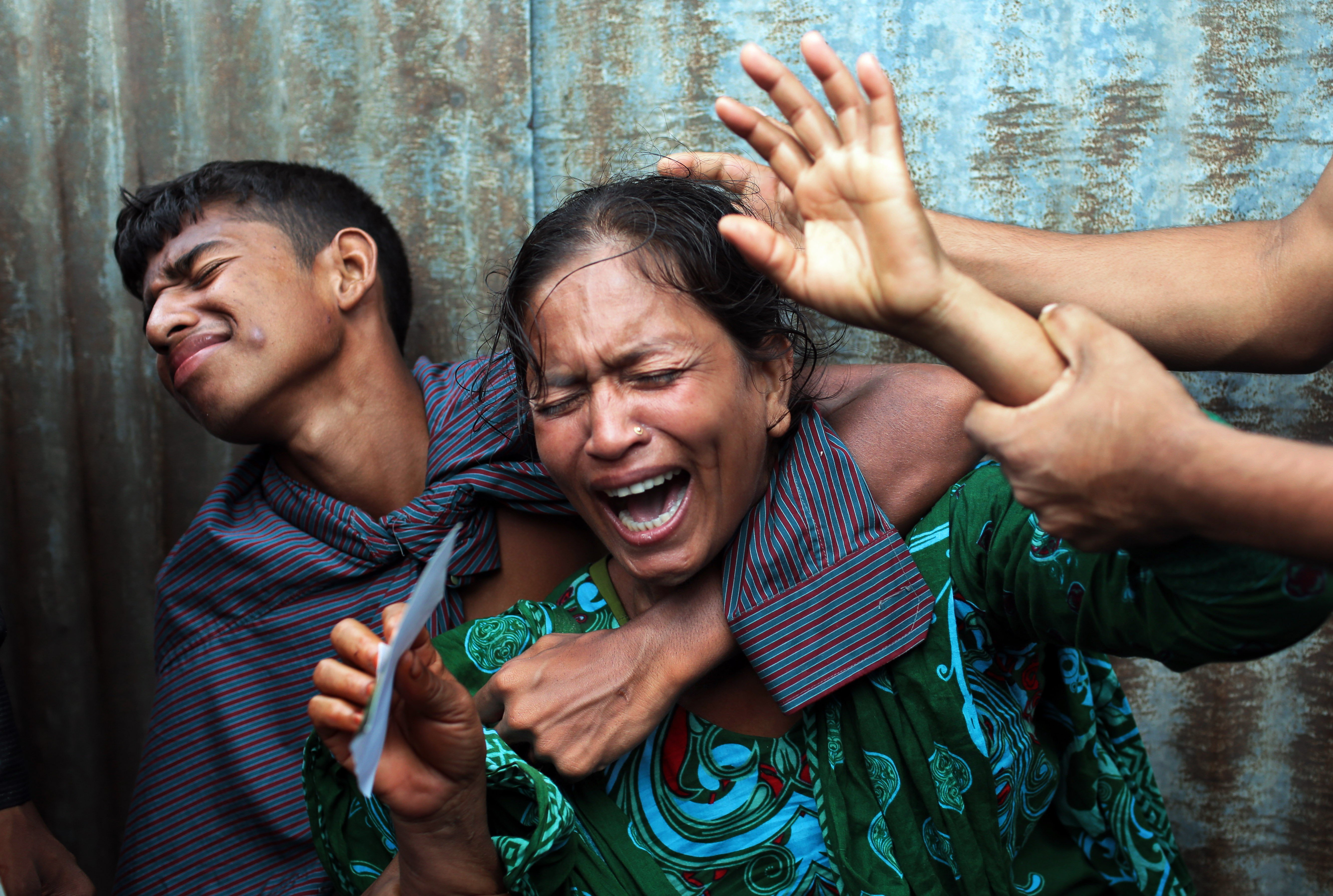 Aug. 4, 2014. Bangladeshi woman Munni, whose daughters are missing, cries as rescuers search the River Padma after a passenger ferry capsized in Munshiganj district, Bangladesh.