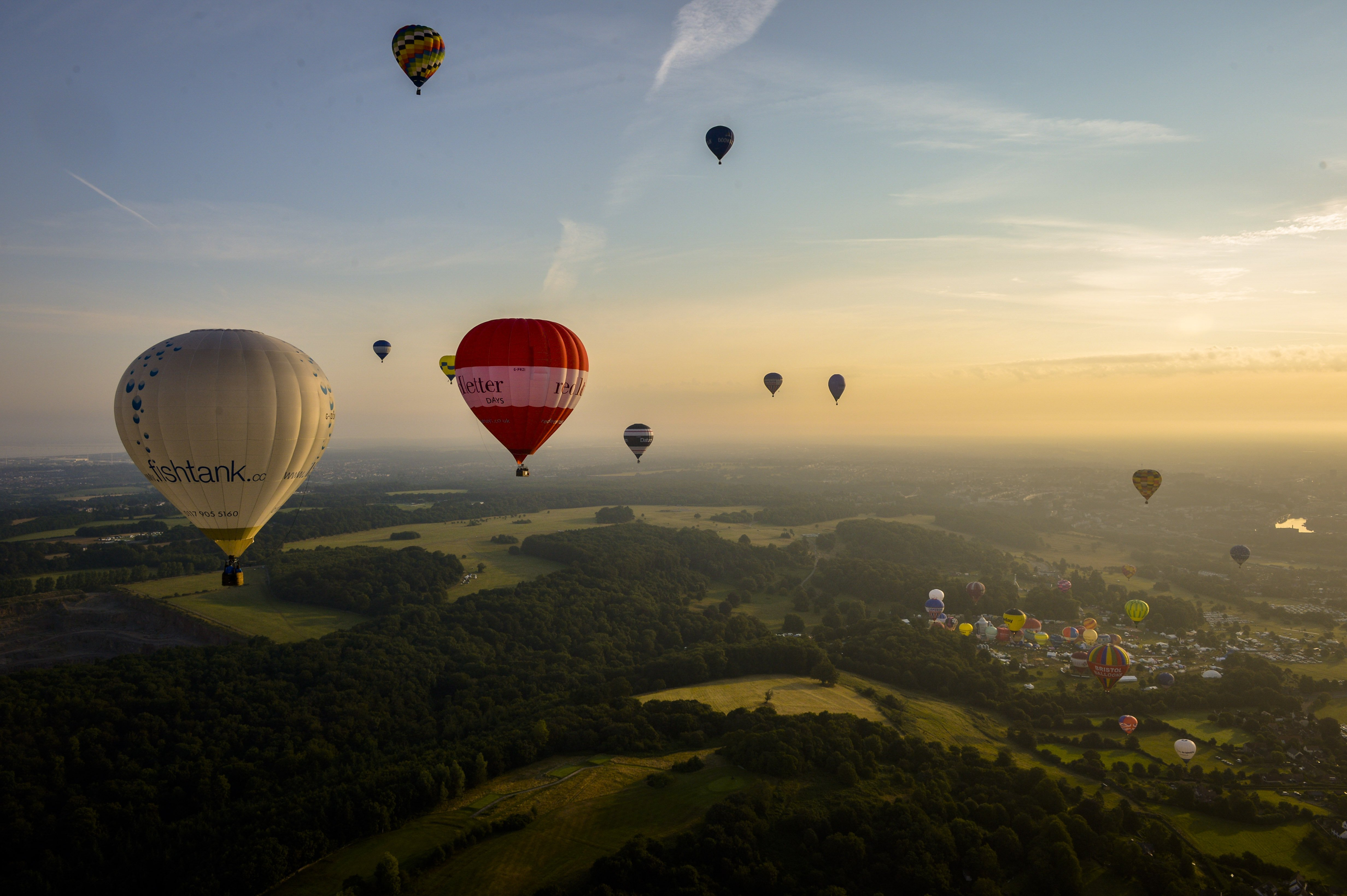 Aug. 8, 2014. Hot air balloons over north Somerset following a mass ascent at the 36th International Balloon Fiesta at the Ashton Court Estate near Bristol, UK, which is Europe's largest ballooning event.