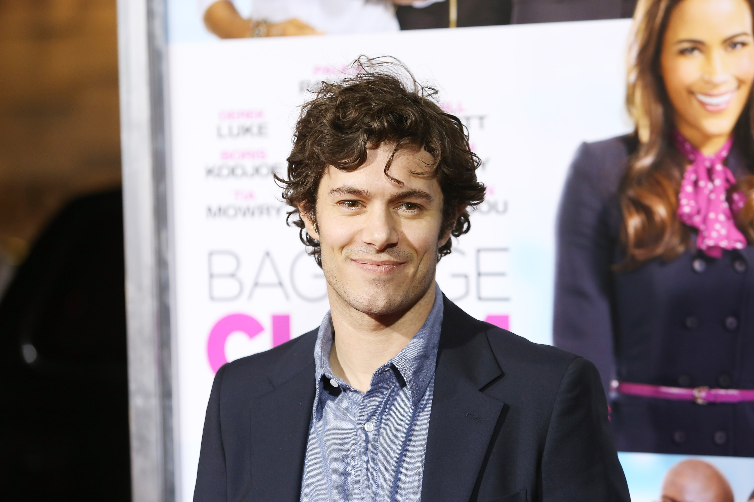 Adam Brody arrives at the Los Angeles premiere of  Baggage Claim  on September 25, 2013.