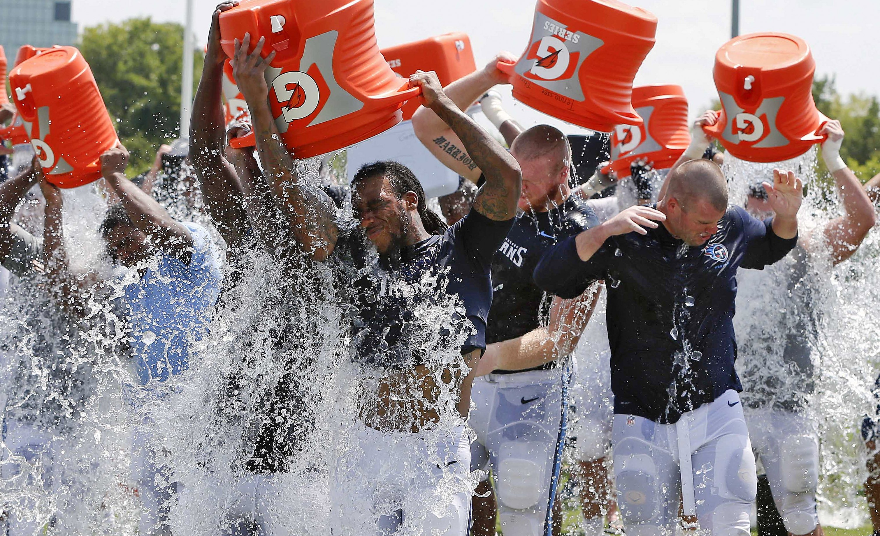 Tennessee Titans players take part in the ALS Ice Bucket Challenge and pour ice water over their heads after NFL football practice Wednesday, Aug. 20, 2014, in Nashville, Tenn.