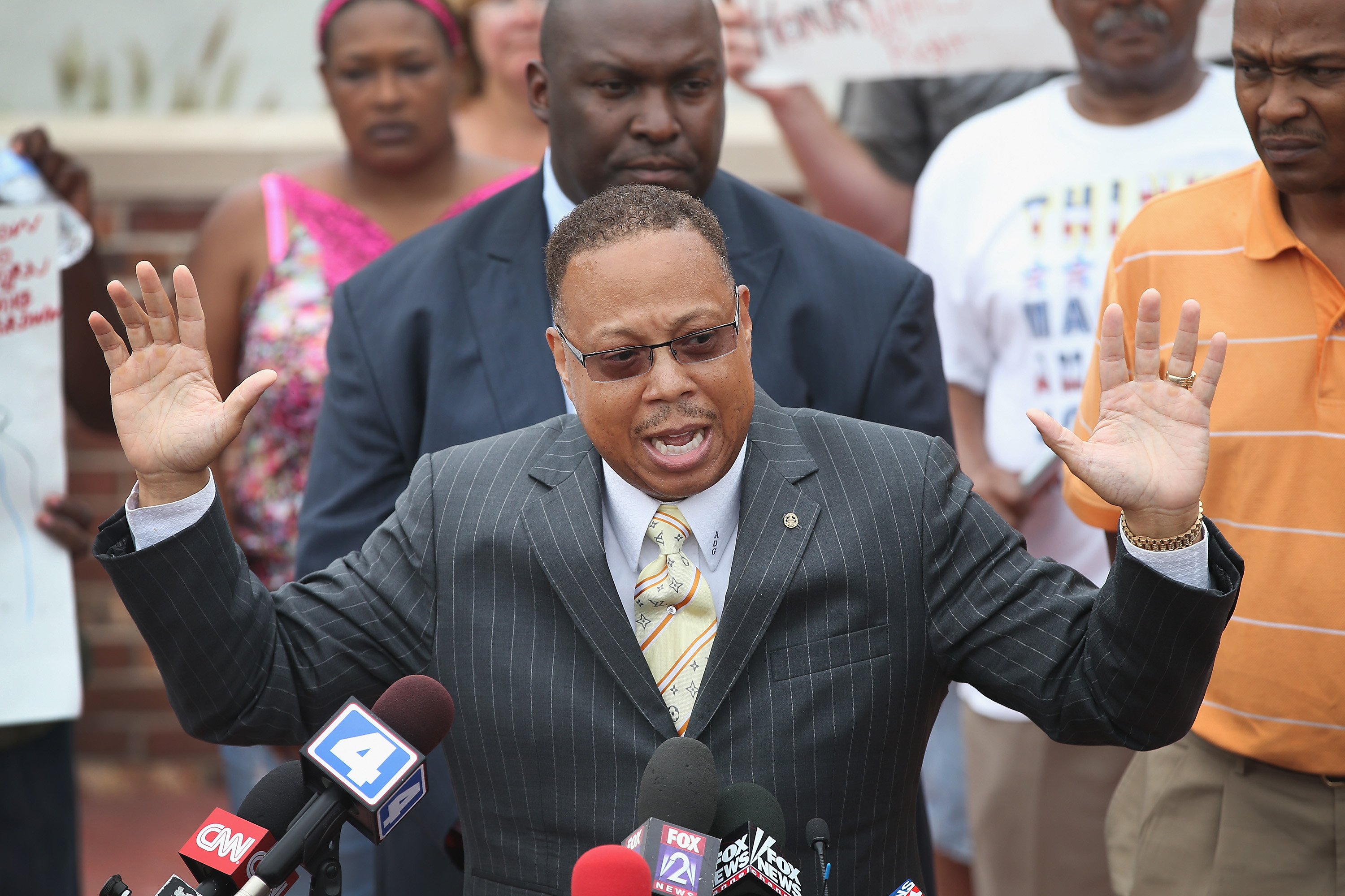 Daryl Parks, an attorney for the family of Michael Brown, addresses the media during a press conference outside the police department on August 15, 2014 in Ferguson, Missouri.