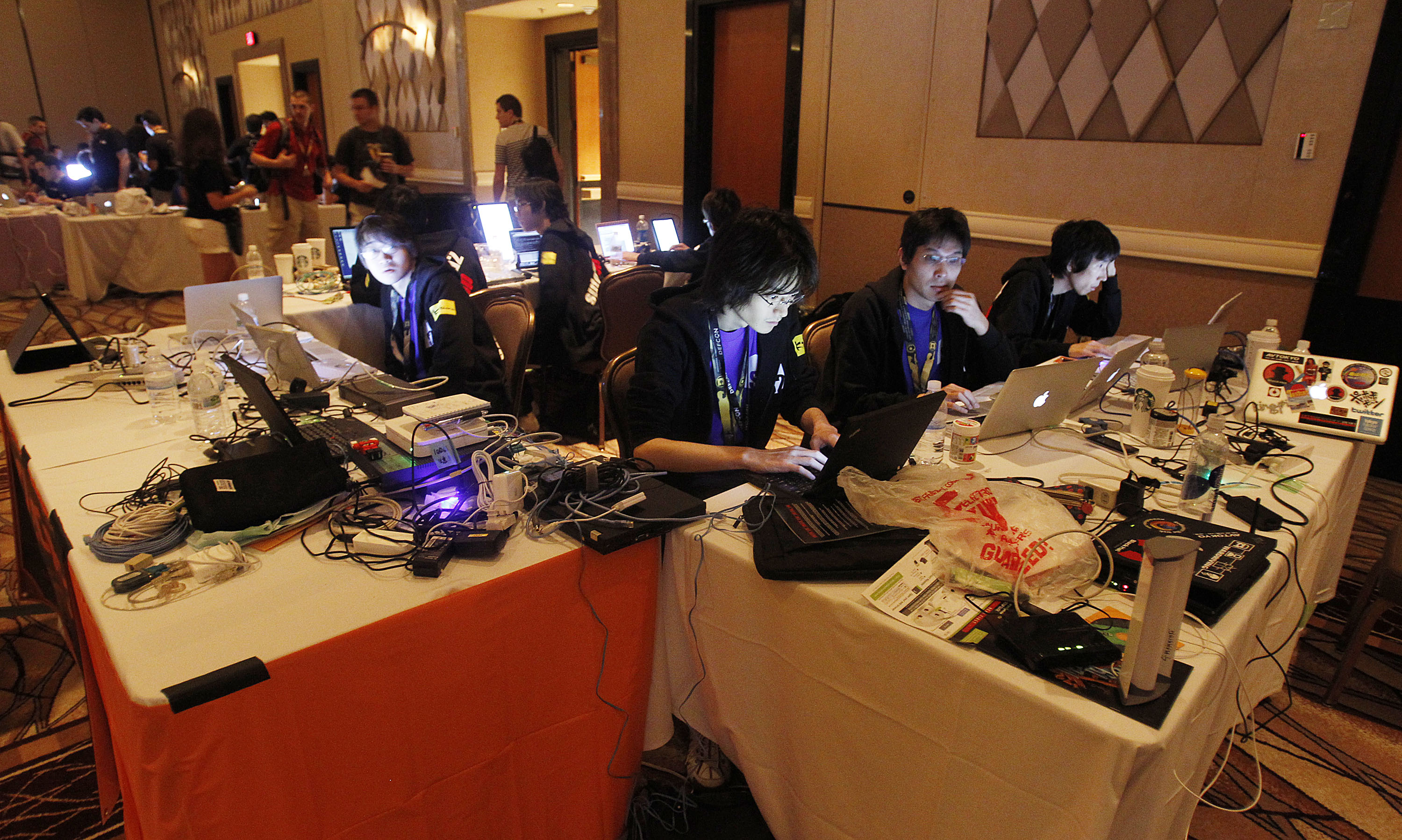 Hackers compete in a digital capture the flag game at the DefCon conference Friday, Aug. 5, 2011, in Las Vegas.