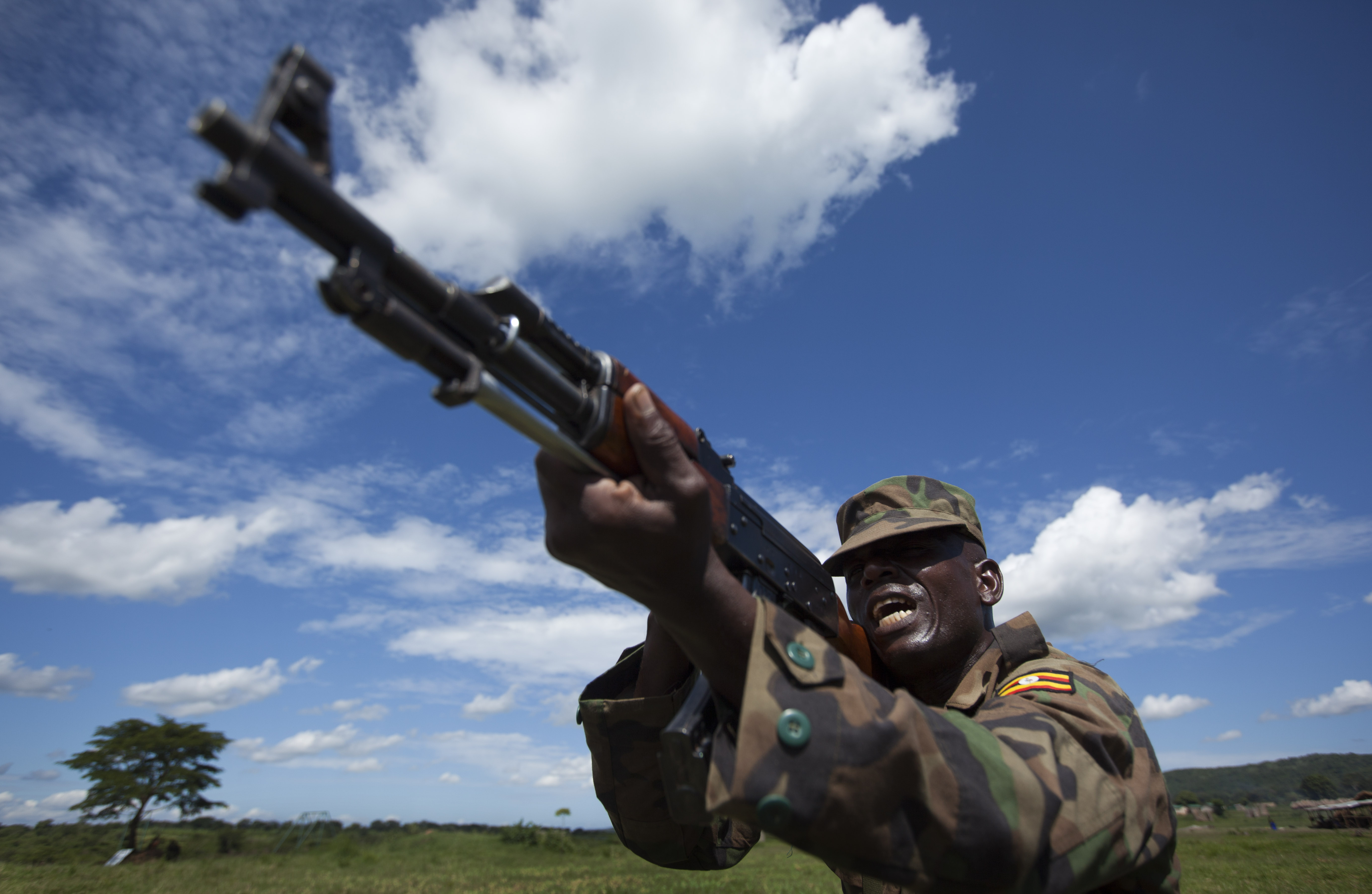 A soldier from the Uganda People's Defence Force (UPDF) engages in weapons training at the Singo training facility in Kakola, Uganda Monday, April 30, 2012. The camp provides different training courses run by the U.S. Marines and also by instructors contracted by the U.S. State Department.
