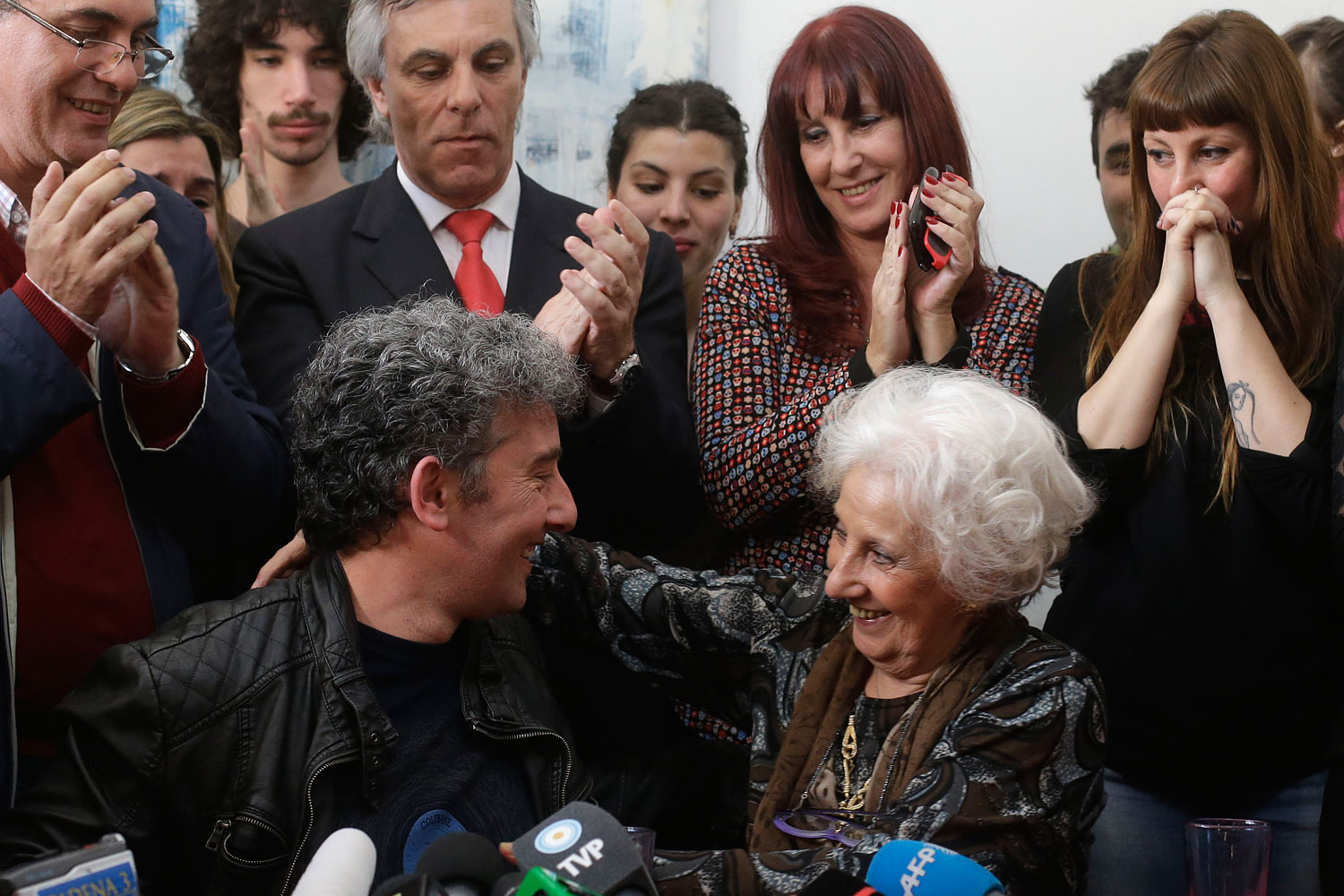 Estela de Carlotto, president of Grandmothers of Plaza de Mayo, right, and her grandson Ignacio Hurban, left, hug during a news conference in Buenos Aires, Aug. 8, 2014.