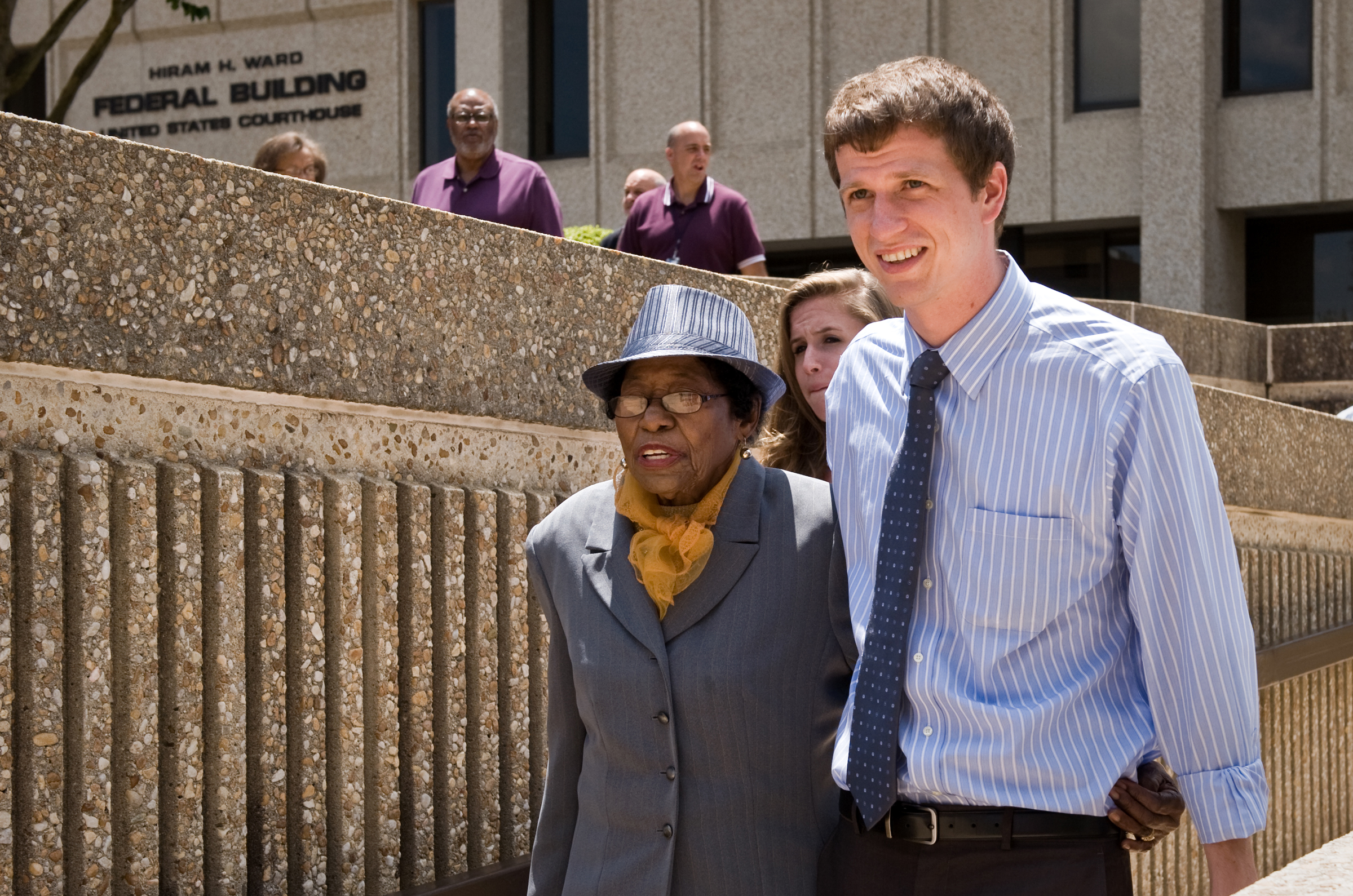Rob Stephens, a field secretary with the North Carolina NAACP, escorts Rosanell Eaton, a plaintiff in the lawsuit challenging the new North Carolina voting law, out of the Ward Federal building during lunch recess on Monday, July 7, 2014 in Winston-Salem, N.C.  The U.S. Justice Department is asking a federal judge in North Carolina to put sweeping changes to the state's voting laws on hold through the November election. The Justice Department argues the Republican-backed measures are designed to suppress turnout at the polls among minorities, the elderly and college students.