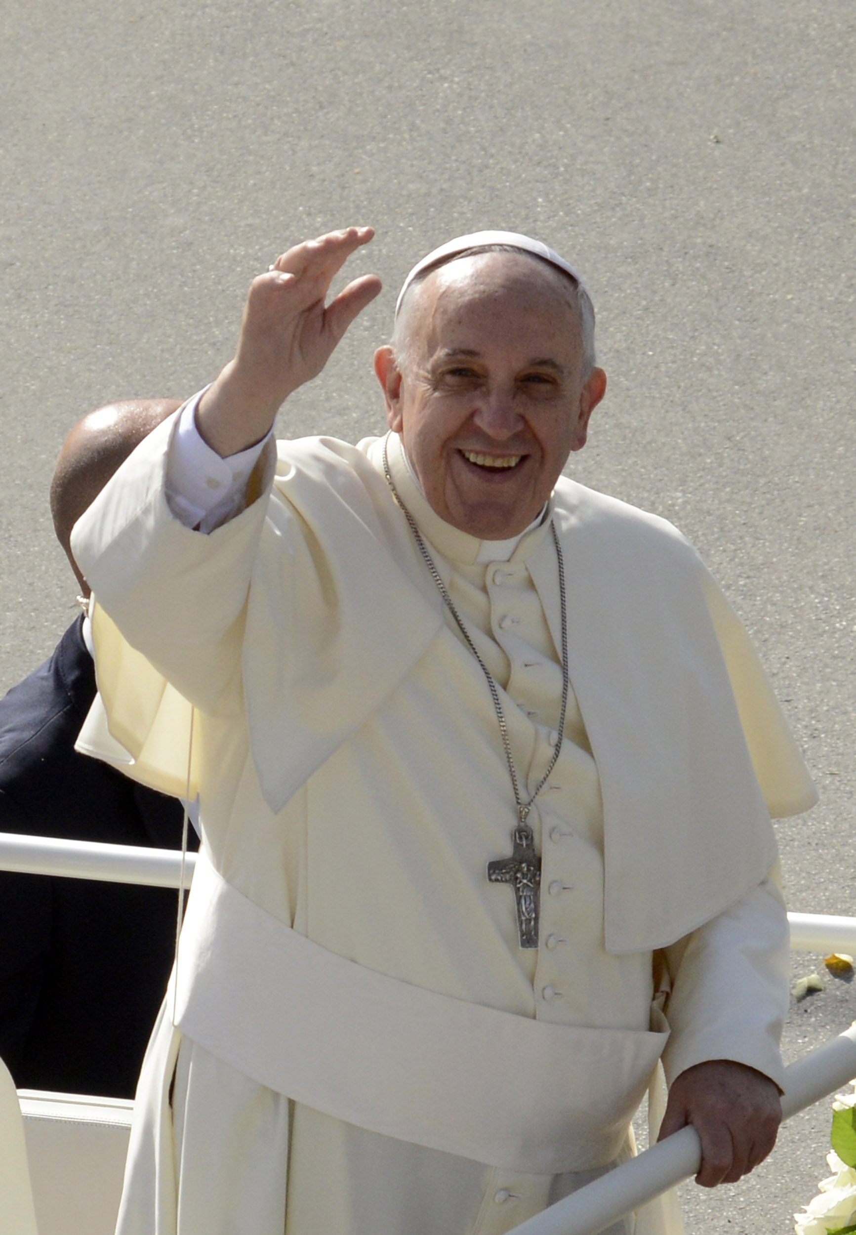 Pope Francis waves as he gets on his pope-mobile after arriving by helicopter in Campobasso, Saturday, July 5, 2014.