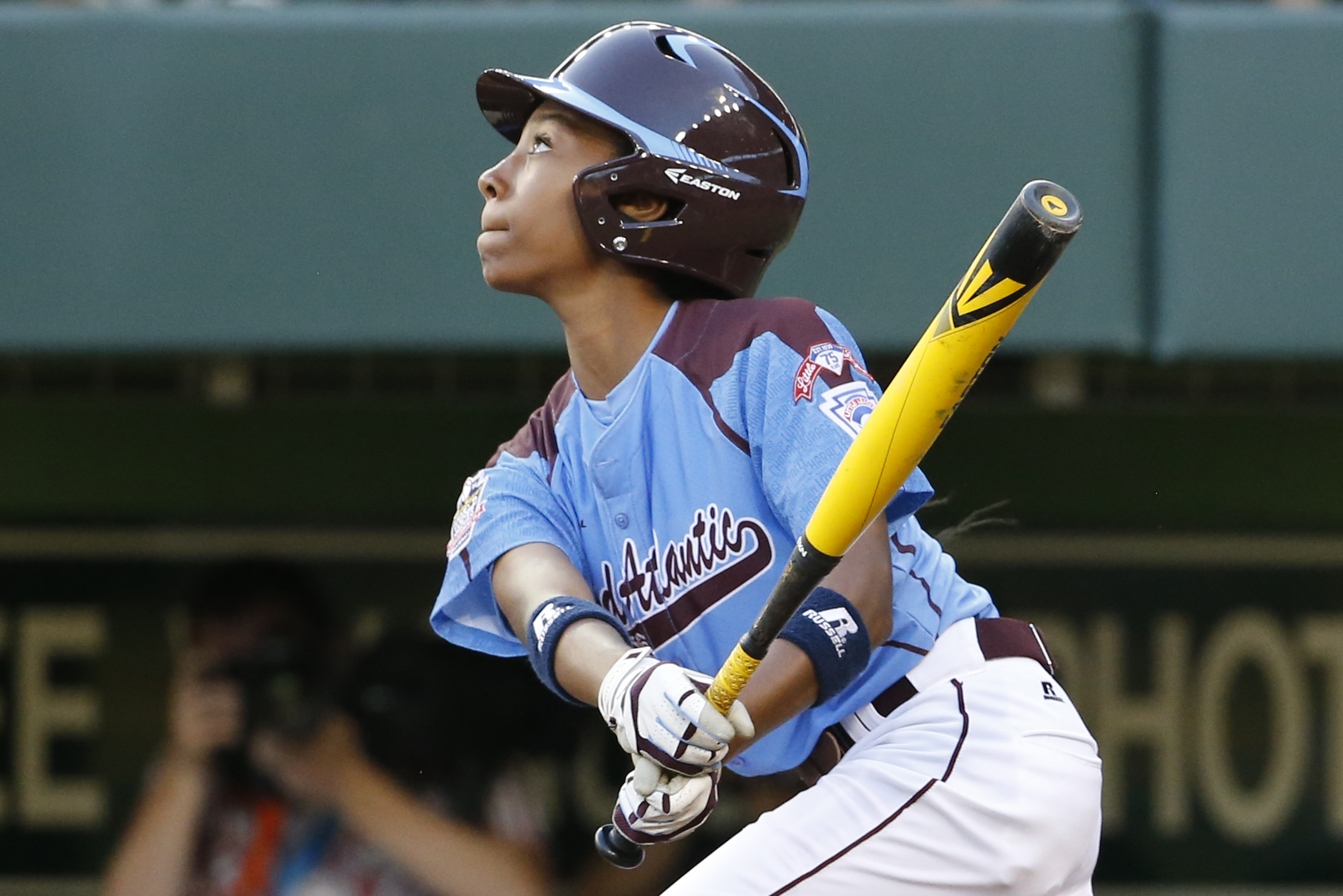 Philadelphia's Mo'ne Davis drives in a run with a single to right field off Pearland  pitcher Clayton Broeder during the first inning of a baseball game at the Little League World Series tournament in South Williamsport, Pa., Sunday, Aug. 17, 2014.