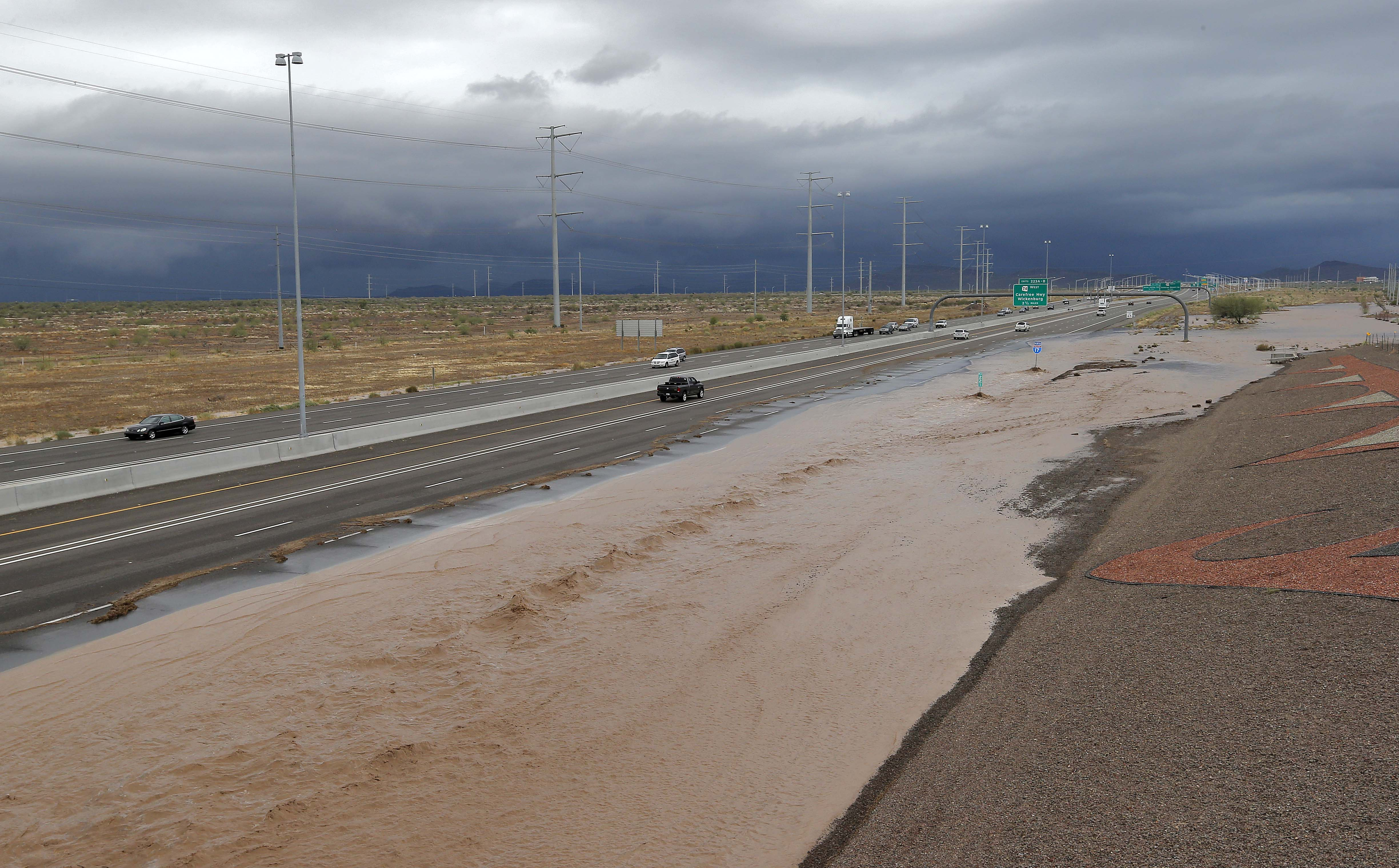 Floodwaters that overran Skunk Creek flood I-10, Aug. 19, 2014, in northwestern Phoenix.