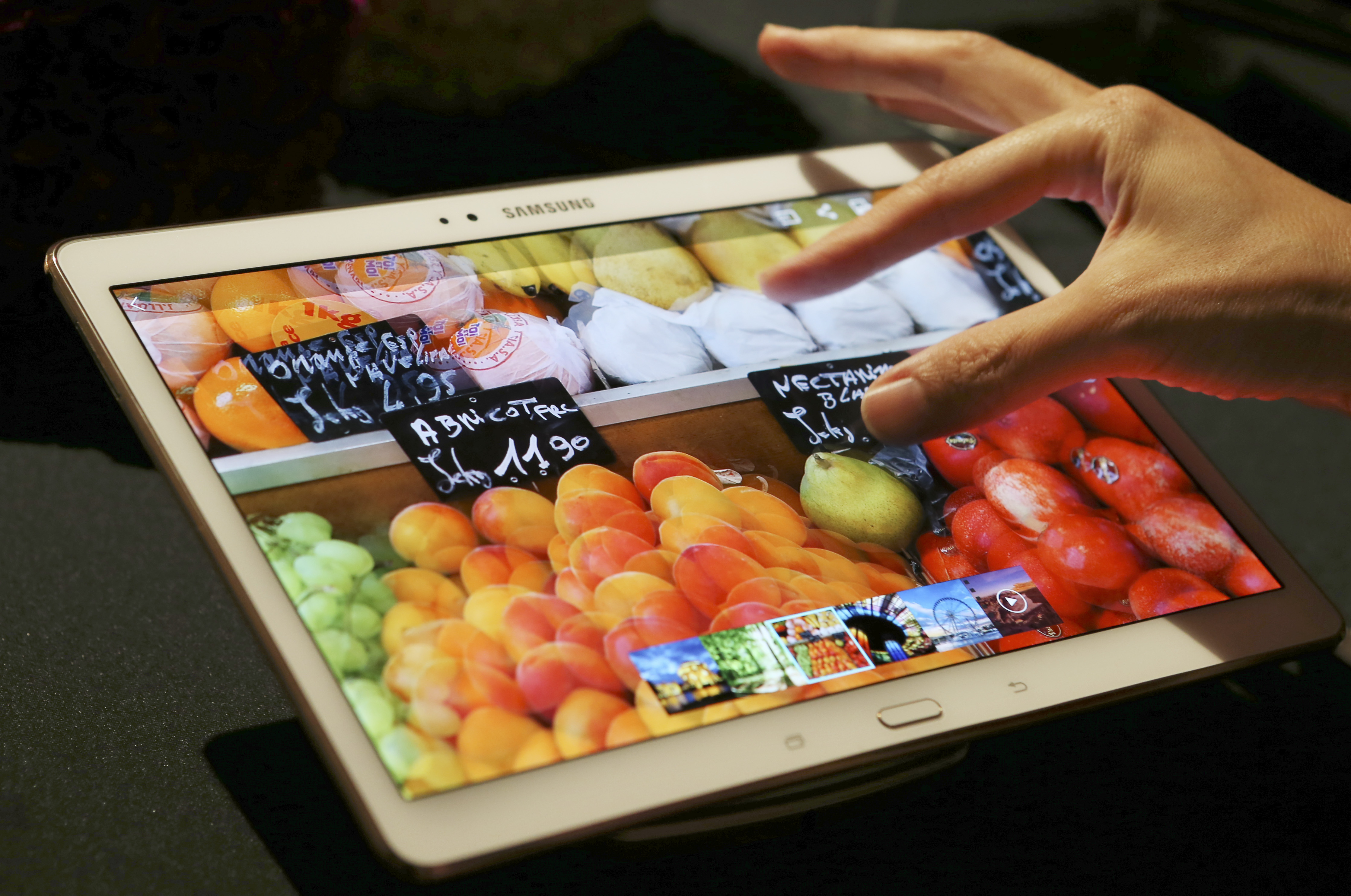 A visitor tries out Samsung Electronics Co.'s 10.5-inch Galaxy Tab S tablet during an event in Tokyo, Japan on July 31, 2014.