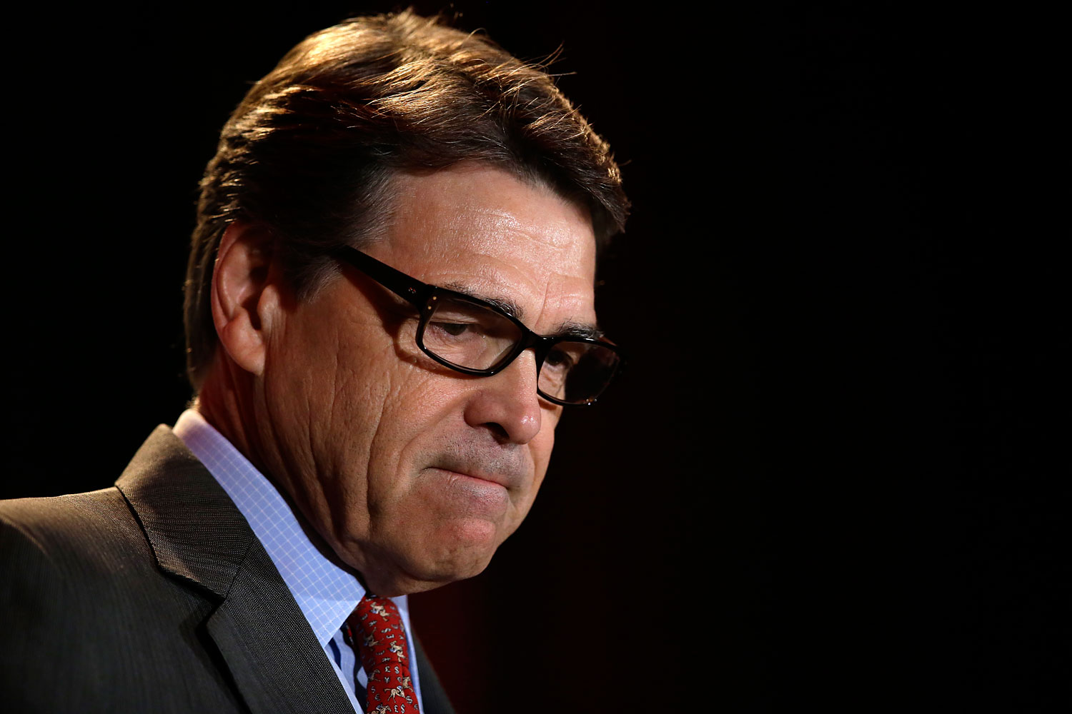 Governor Rick Perry pauses as he addresses attendees at the 2014 Red State Gathering, Aug. 8, 2014, in Fort Worth, Texas.