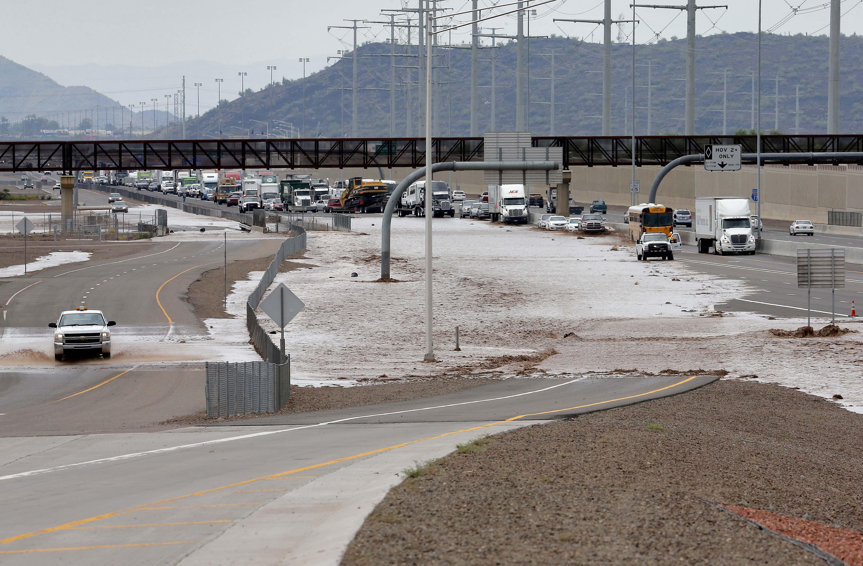 Waters that overran Skunk Creek flood I-10, Aug. 19, 2014, in northwestern Phoenix.