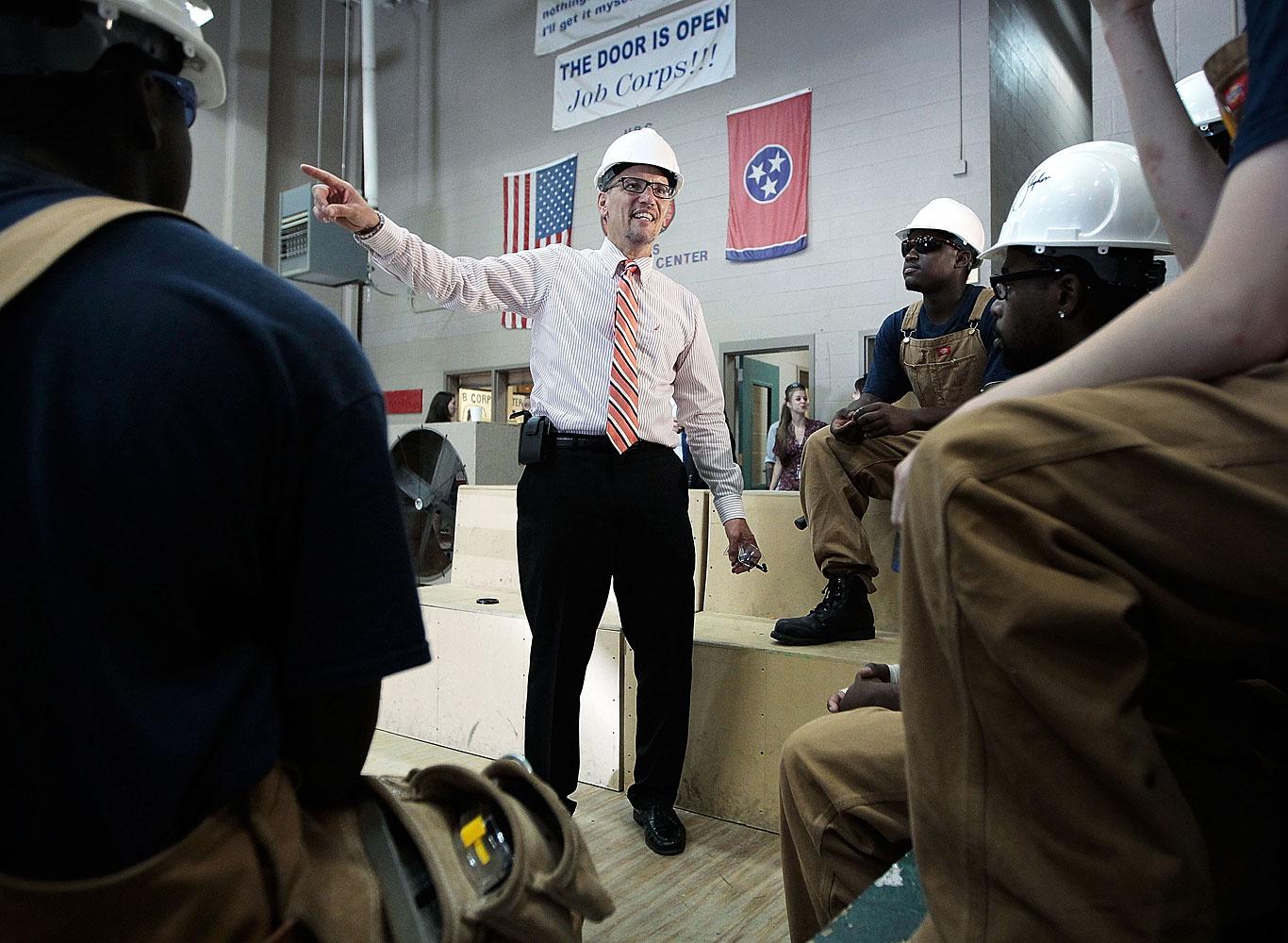 U.S. Labor Secretary Thomas Perez talks with carpentry students during a trip to the Benjamin L. Hooks Job Corps Center in Memphis, Tenn., Aug. 20, 2014.