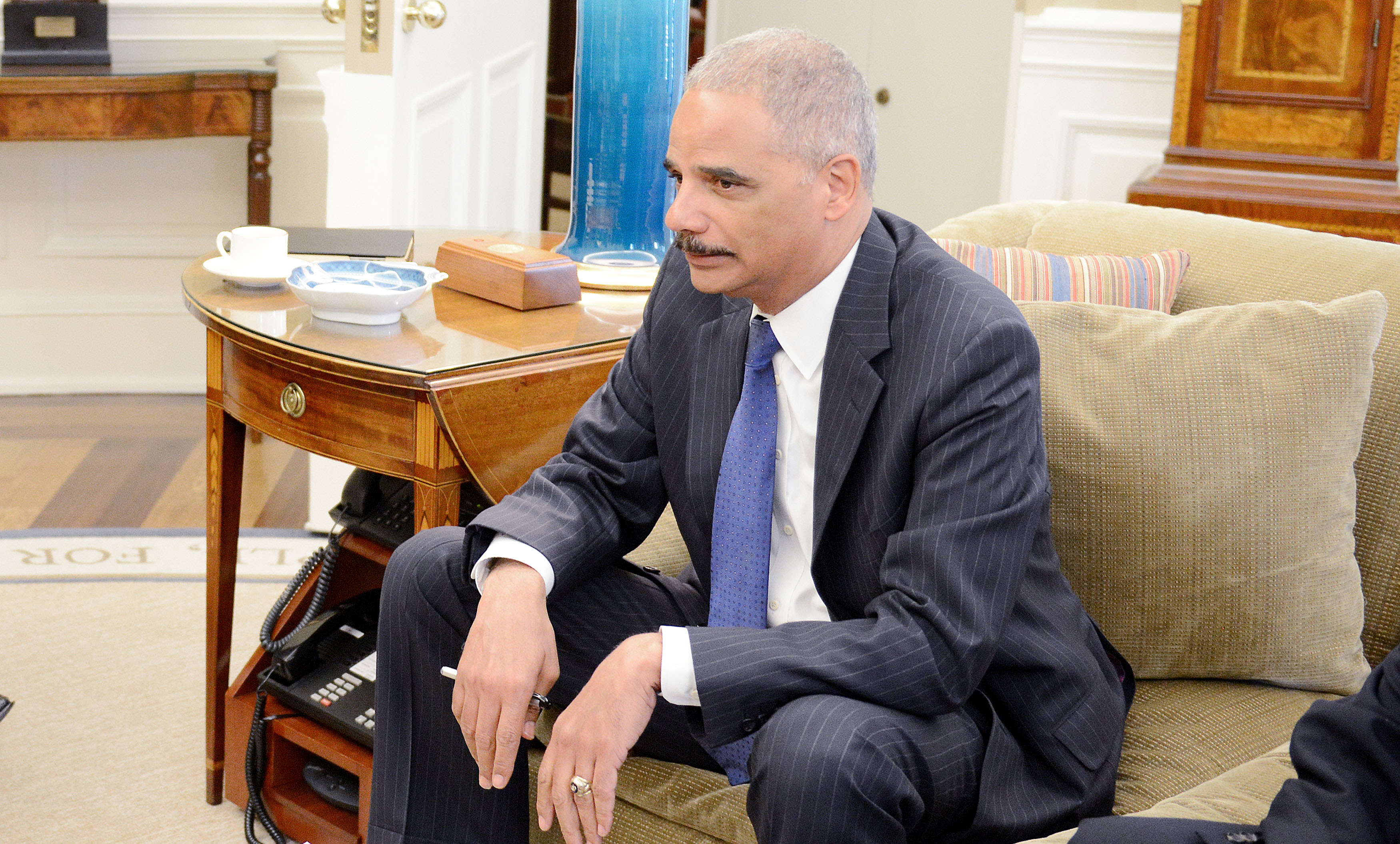 United States Attorney General Eric Holder looks on during a meeting in the Oval office of the White House with U.S. President Obama to receive an update on the situation in Ferguson, Missouri August 18, 2014 in Washington, DC.