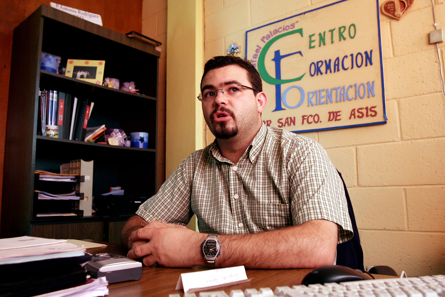 In this Tuesday Oct. 24, 2006 file photo, Roman Catholic priest Antonio Rodriguez Tercero explains the function of the youth center in the San Salvador suburb Mejicanos, El Salvador.