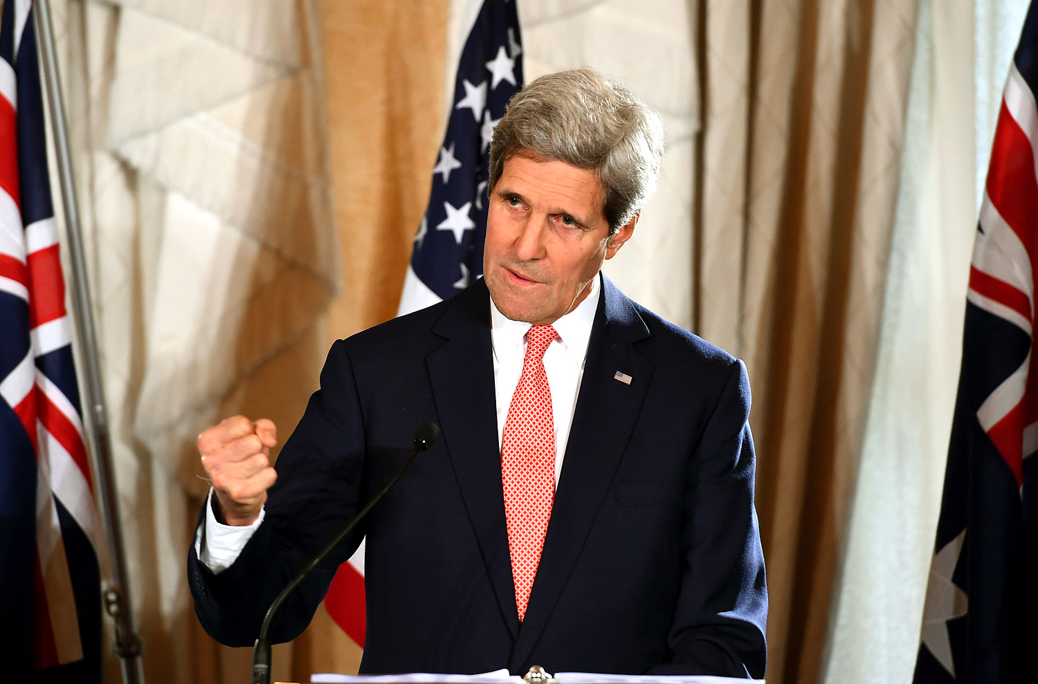 FILE - In this Aug. 12, 2014 file photo, U.S. Secretary of State John Kerry gestures as he speaks to the media during a press conference at the conclusion of the AUSMIN talks at Admiralty House in Sydney, Aug. 12, 2014.