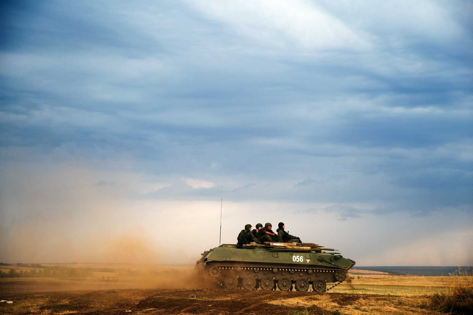 A Russian APC moves in a field in about 10 kilometers (6.2 miles) from the Russia-Ukrainian border control point at Russian town of Donetsk, Rostov-on-Don region on Aug. 18, 2014.