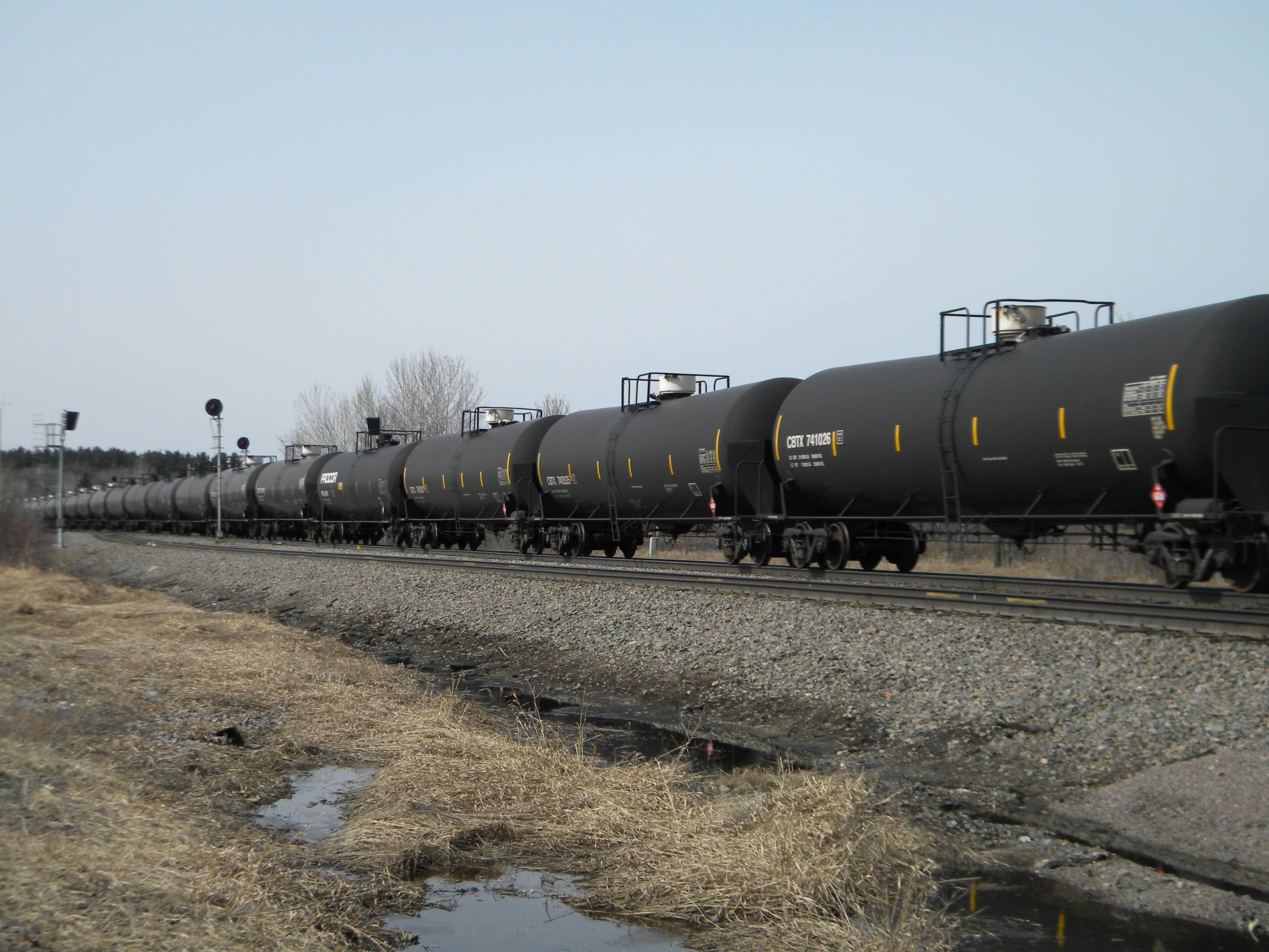 An oil-tank train with crude oil from the Bakken shale fields of North Dakota travels near Staples, Minn., on April 15, 2014