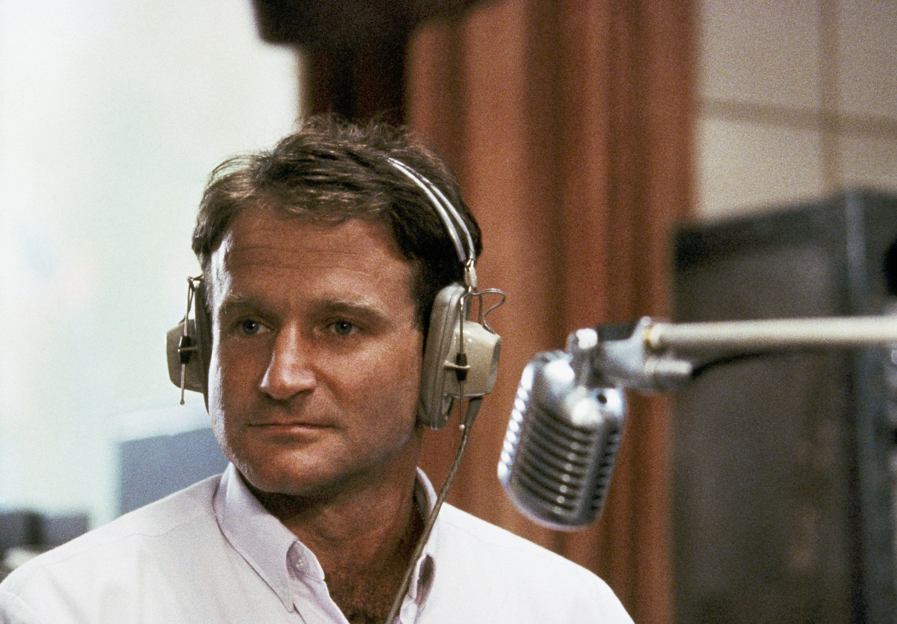 Robin Williams played radio DJ Adrian Cronauer in director Barry Levinson's comedy drama, <i>Good Morning Vietnam</i> in 1987.