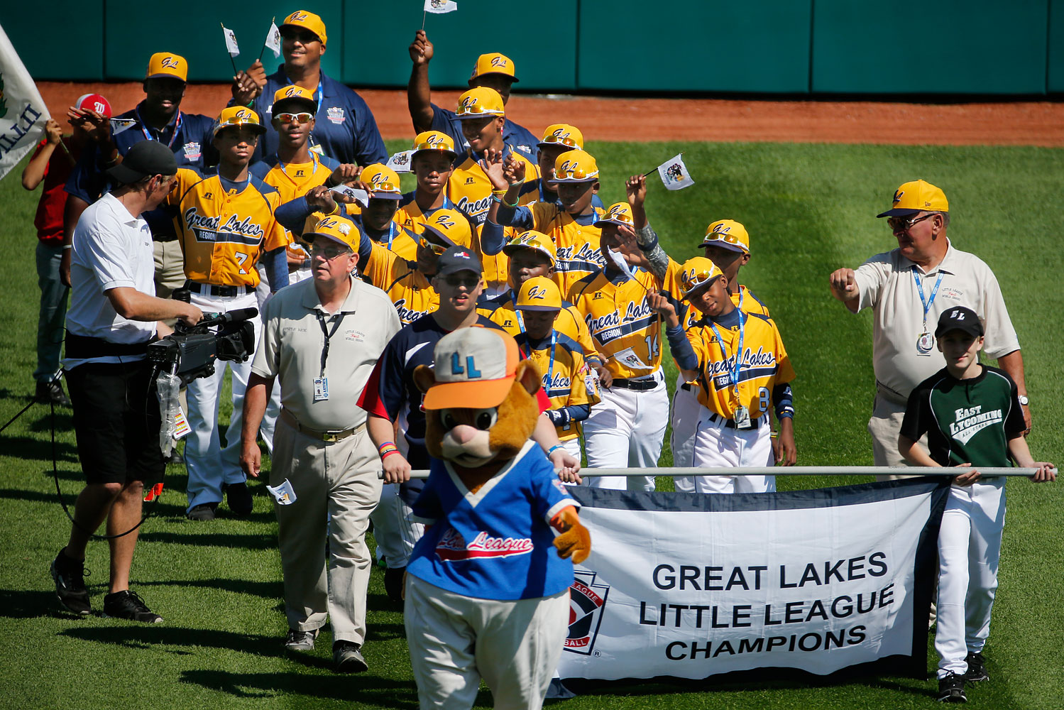 The Jackie Robinson West Little League baseball team from Chicago participates in the opening ceremony of the 2014 Little League World Series tournament in South Williamsport, Pa., Aug. 14, 2014.