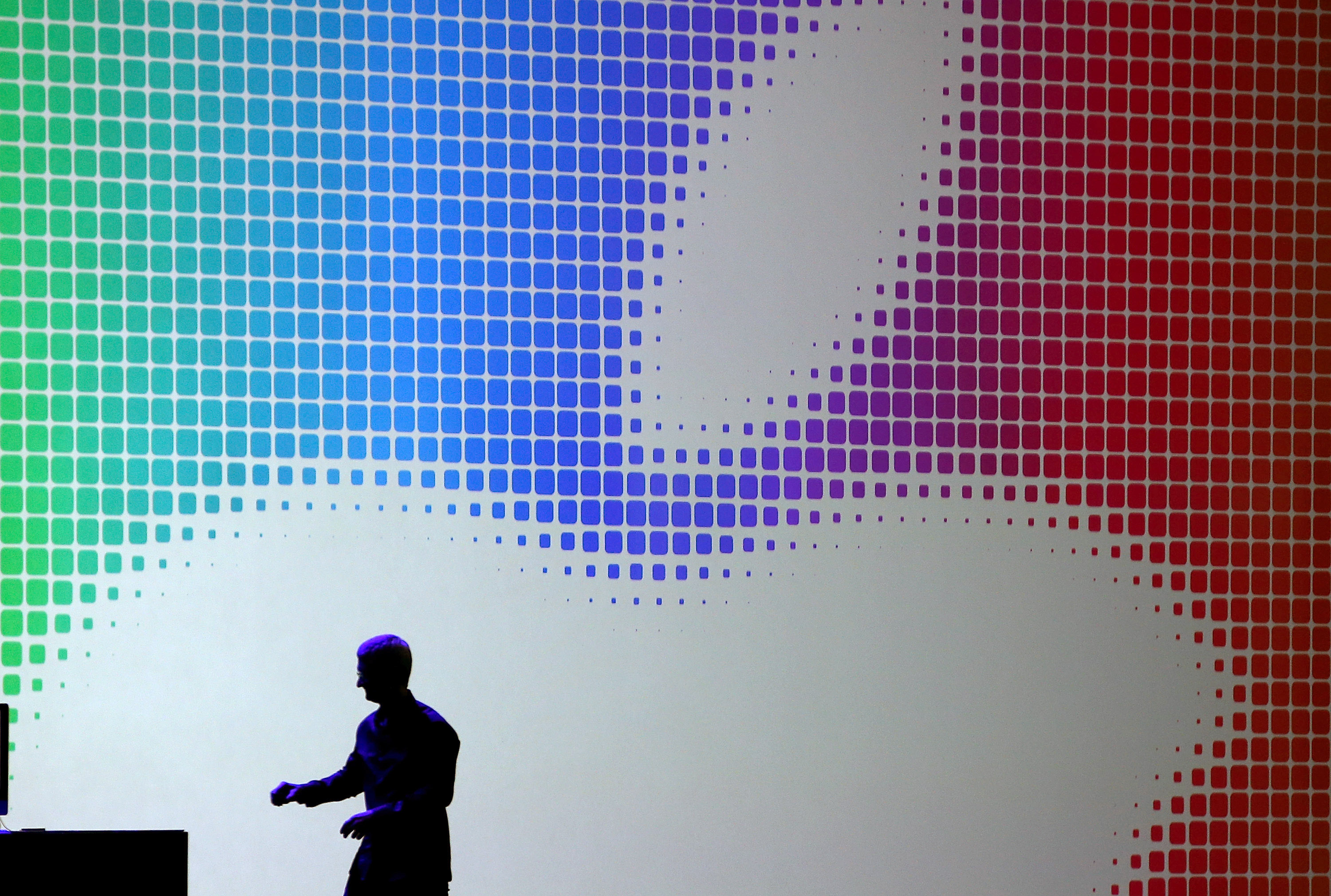 Apple CEO Tim Cook walks off stage after speaking during the Apple Worldwide Developers Conference at the Moscone West center on June 2, 2014 in San Francisco, California.