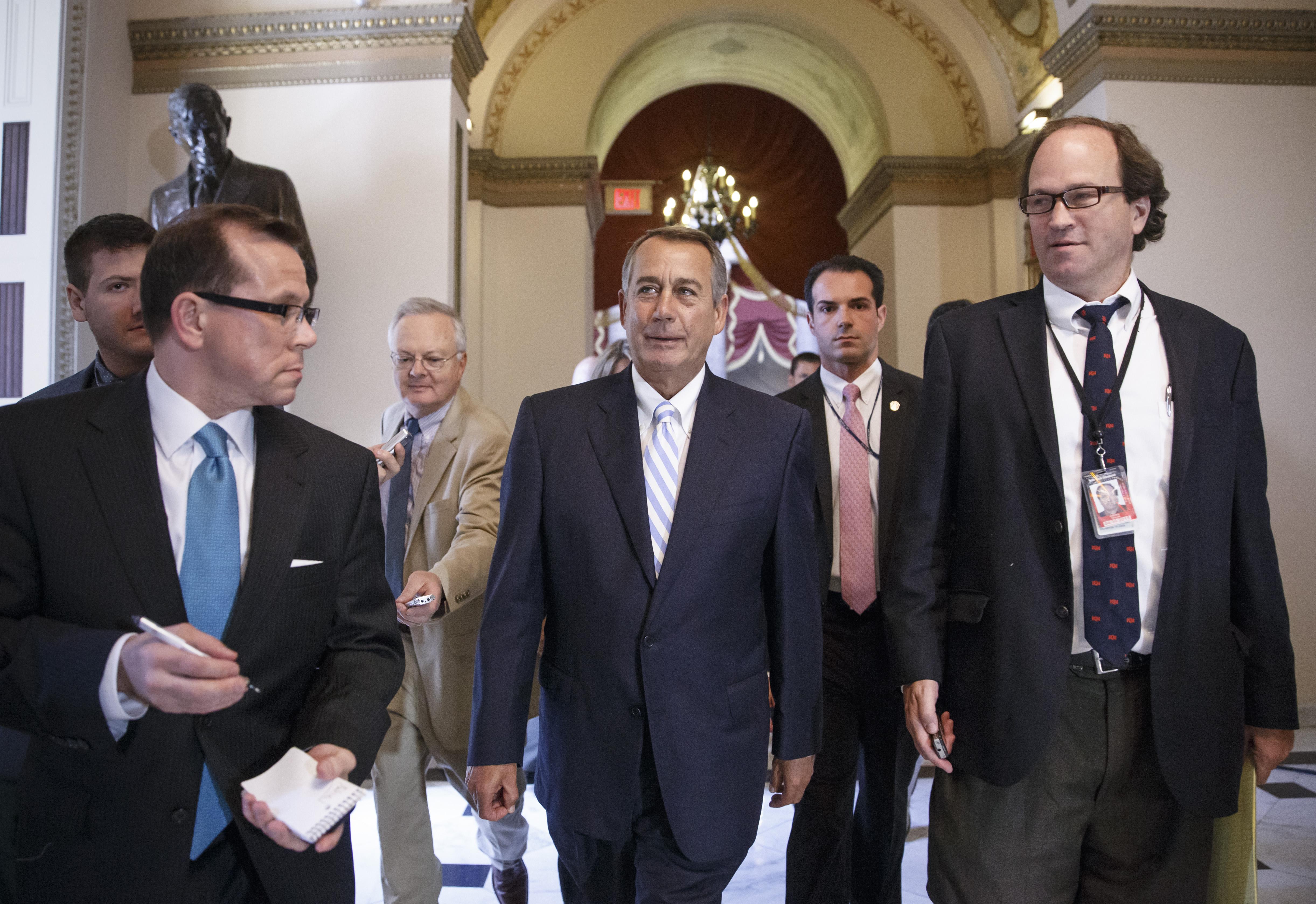 House Speaker John Boehner, center, walks to the House chamber on Capitol Hill on July 31, 2014