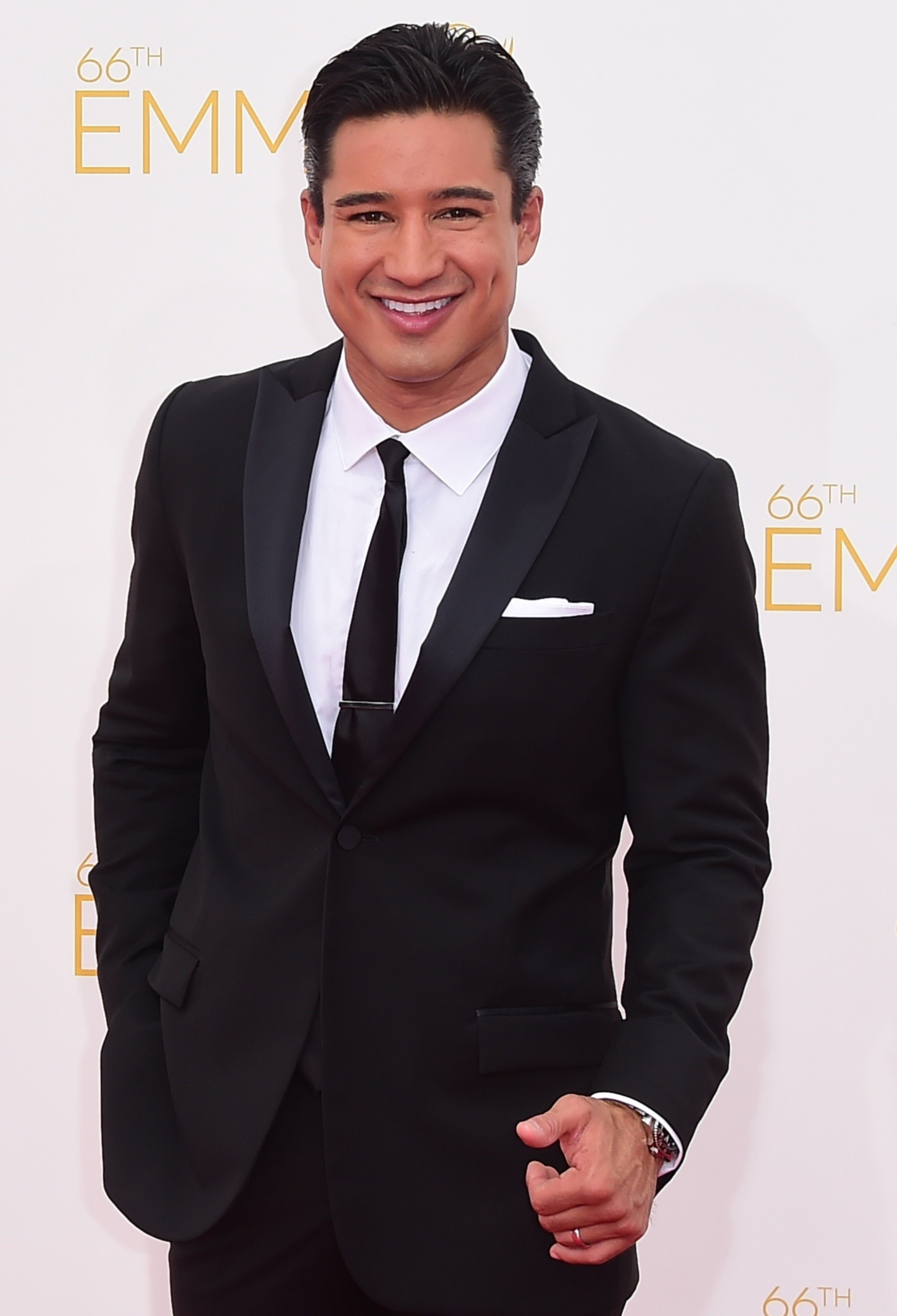 Mario Lopez  arrives on the red carpet for the 66th Emmy Awards, August 25, 2014 at Nokia Theatre in Los Angeles, California.