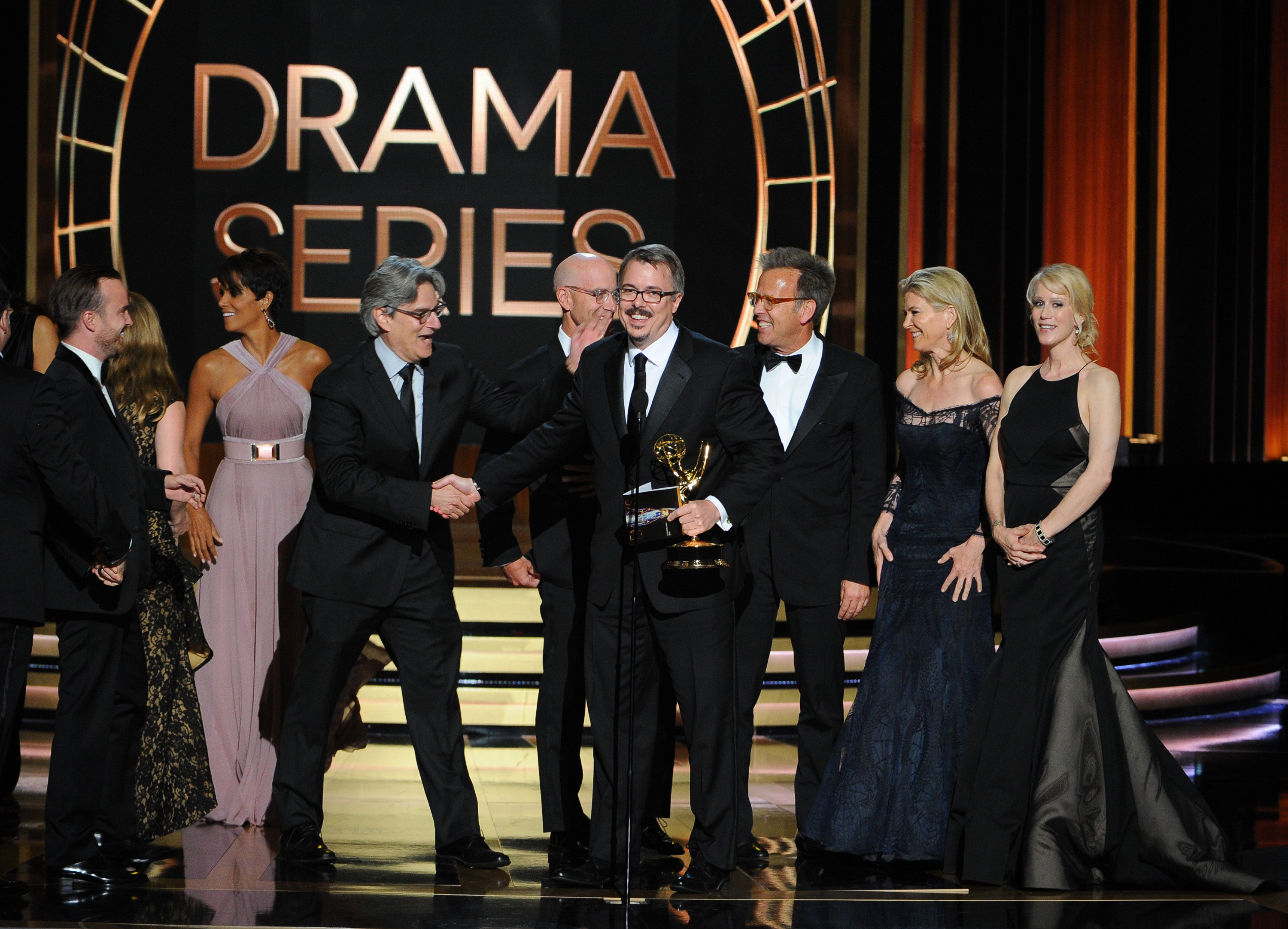 """Vince Gilligan, center, and the cast and producers of """"Breaking Bad"""" accept the award for outstanding drama series at the 66th Primetime Emmy Awards at the Nokia Theatre L.A. Live on Monday, Aug. 25, 2014, in Los Angeles."""