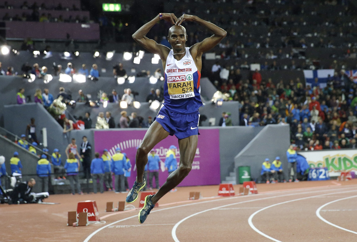 Britain's Mo Farah dances as he celebrates winning the gold medal in the men's 10,000m final during the European Athletics Championships in Zurich on August 13, 2014.