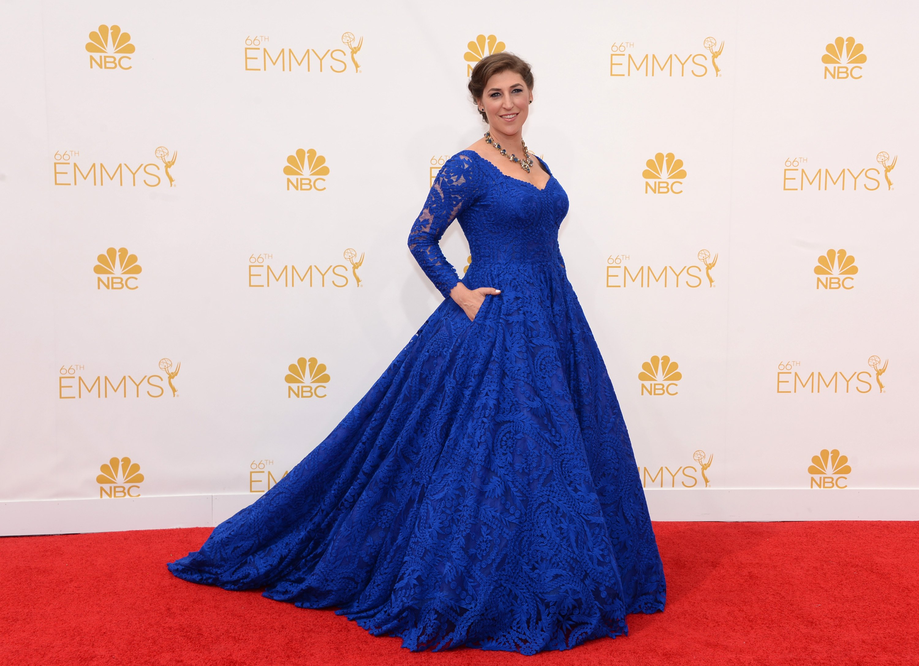 Mayim Bialik arrives at the 66th Primetime Emmy Awards at the Nokia Theatre L.A. Live on Monday, Aug. 25, 2014, in Los Angeles.