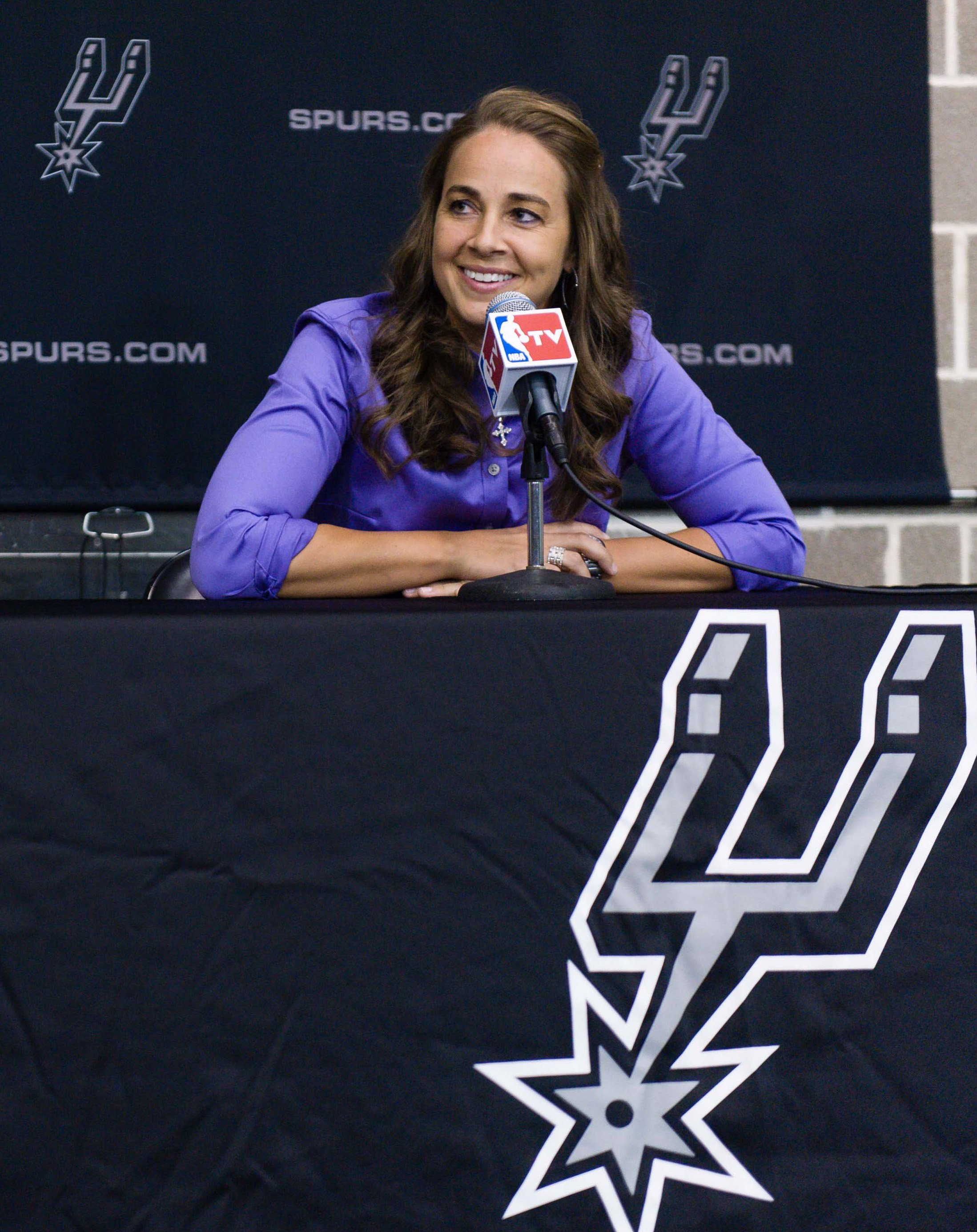 WNBA star Becky Hammon takes questions from the media at the San Antonio Spurs practice facility after being introduced as an assistant coach with the team on Tuesday, Aug. 5, 2014 in San Antonio.