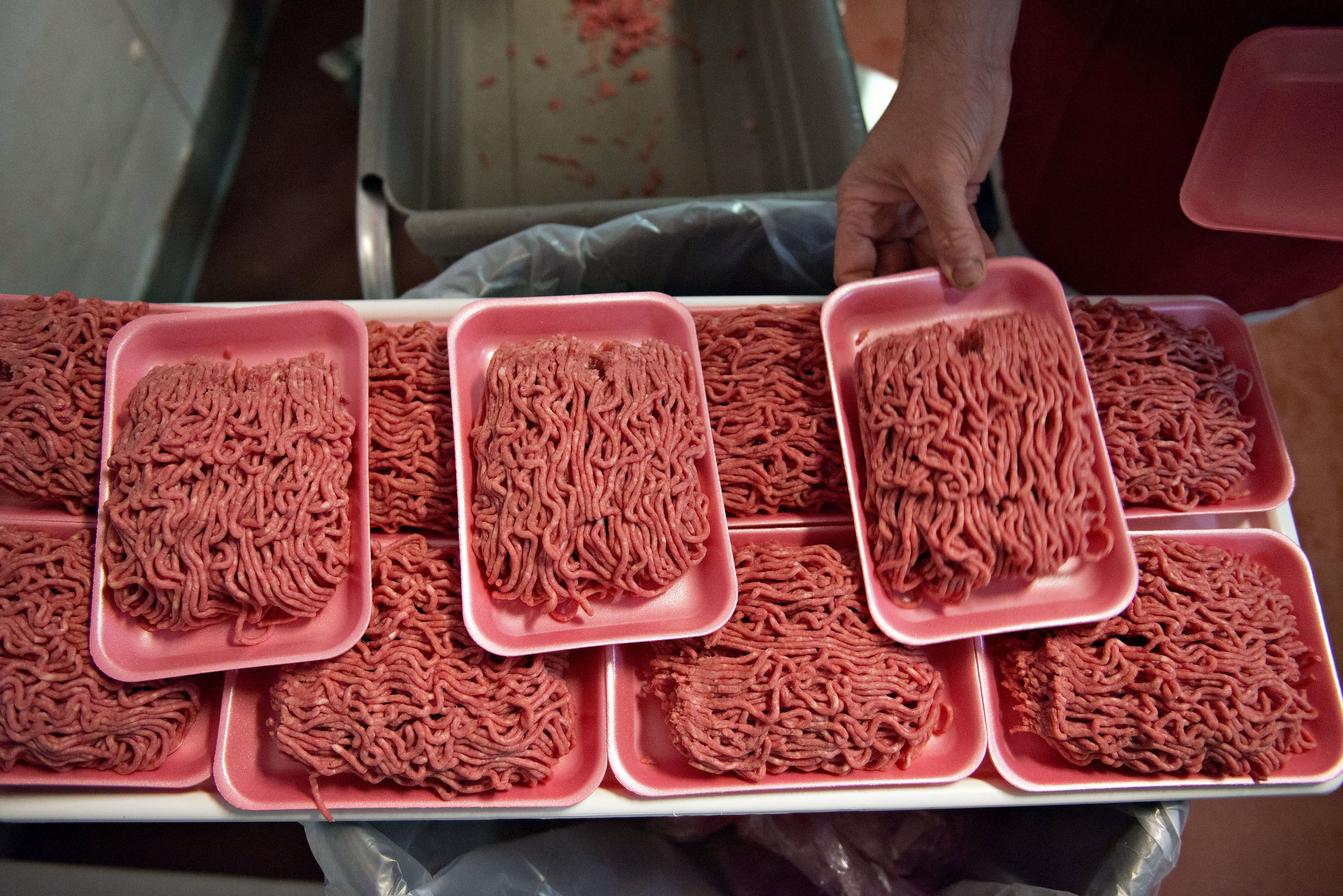 Ground beef is portioned onto trays at a supermarket meat department, July 2, 2014.